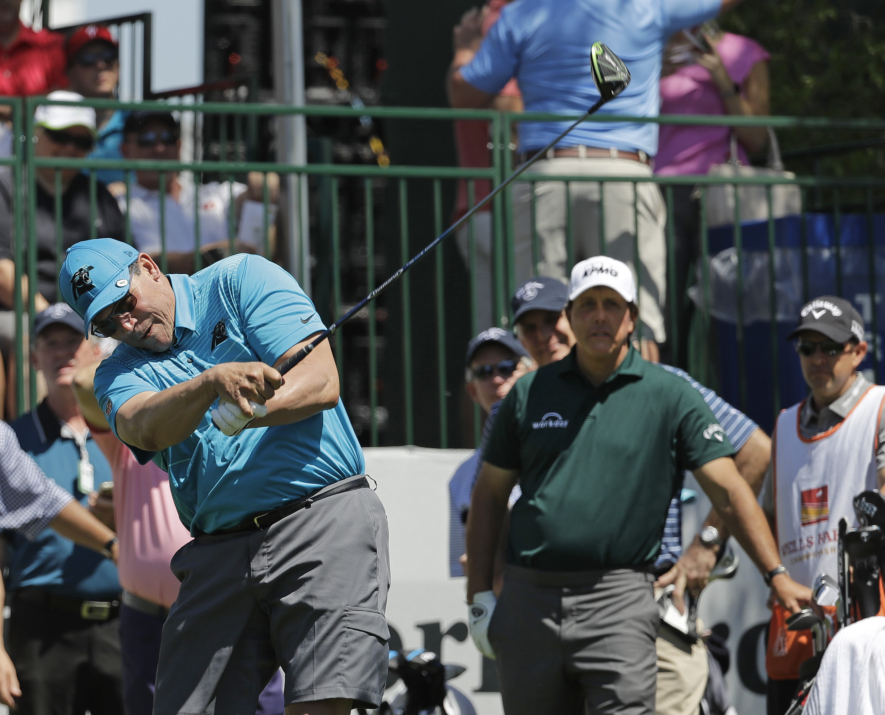 "<div class=""meta image-caption""><div class=""origin-logo origin-image ap""><span>AP</span></div><span class=""caption-text"">Carolina Panthers head coach Ron Rivera, left, hits his tee shot as Phil Mickelson, right, watches on the 10th hole. (Chuck Burton)</span></div>"