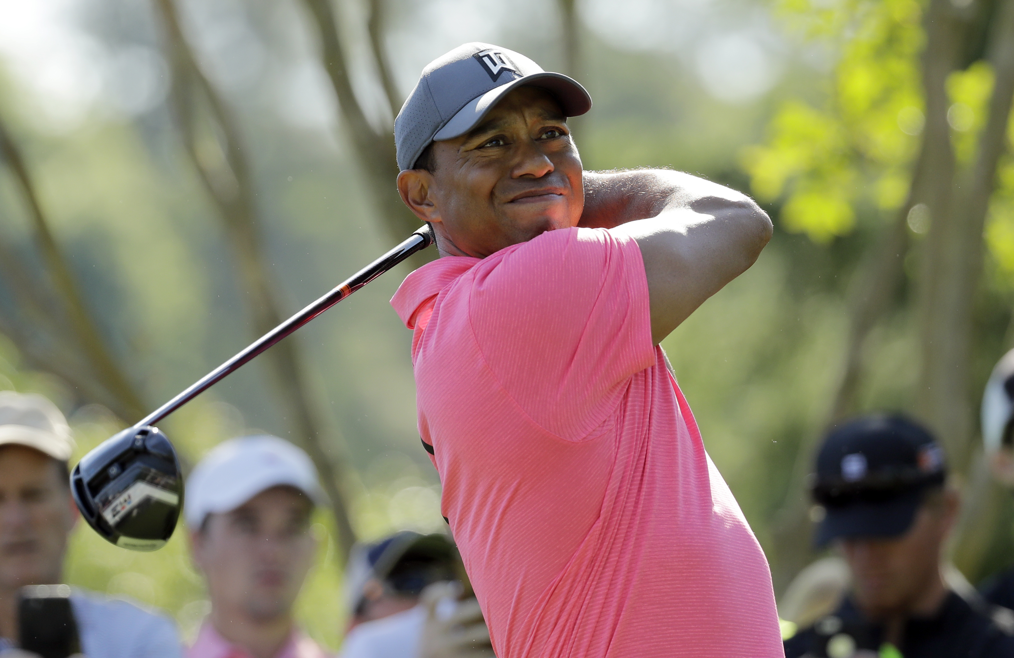 "<div class=""meta image-caption""><div class=""origin-logo origin-image ap""><span>AP</span></div><span class=""caption-text"">Tiger Woods watches his tee shot on the 11th hole. (Chuck Burton)</span></div>"