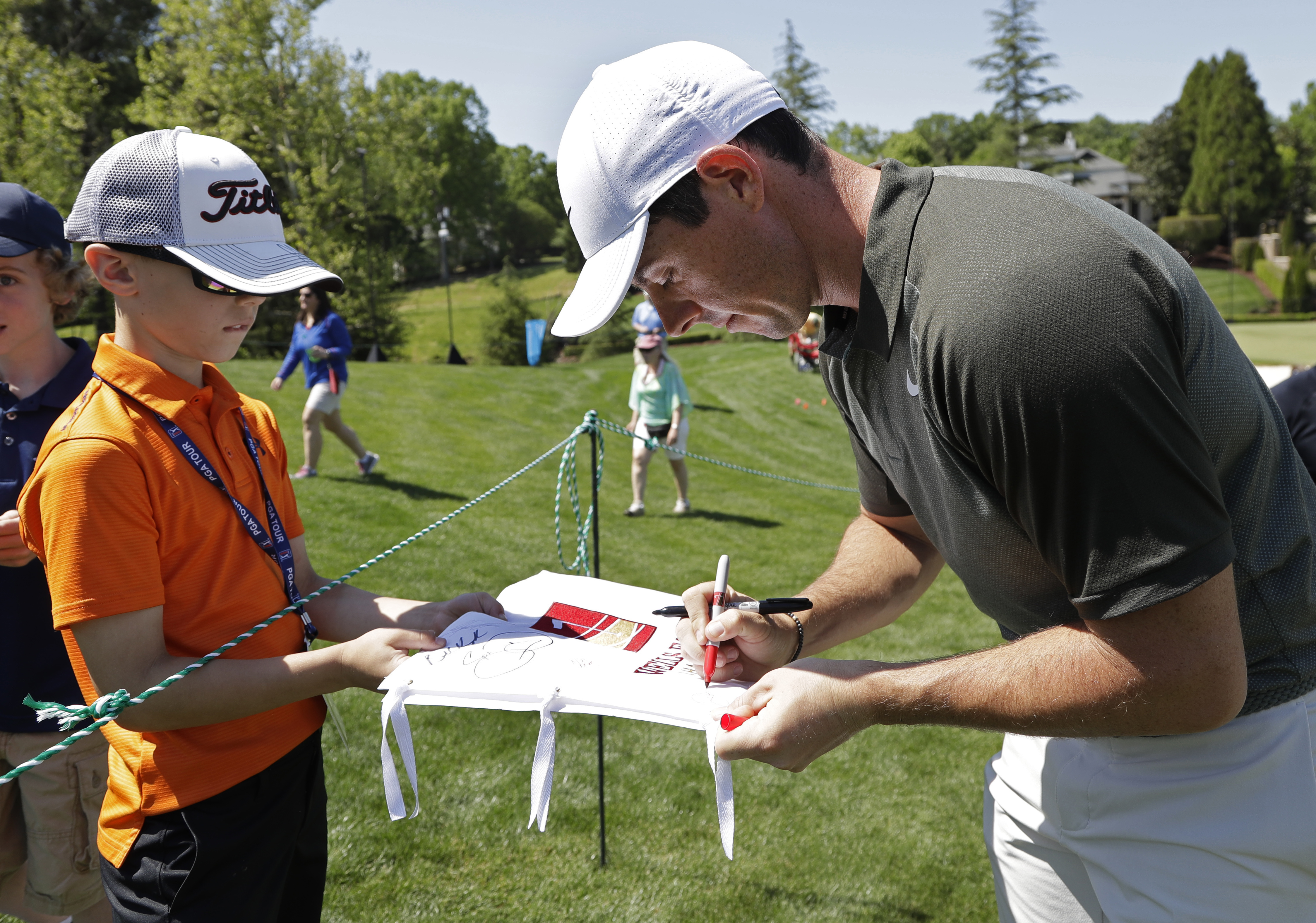 "<div class=""meta image-caption""><div class=""origin-logo origin-image ap""><span>AP</span></div><span class=""caption-text"">Rory McIlroy, of Northern Ireland, signs an autograph for a fan on the seventh hole. (Chuck Burton)</span></div>"