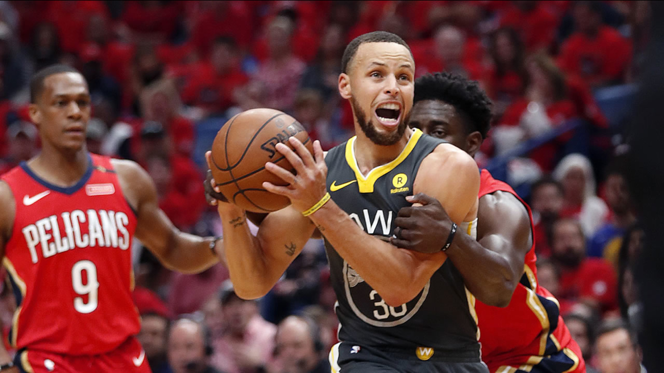 5574b7a70f10 Warriors guard Stephen Curry is fouled by New Orleans Pelicans guard Jrue  Holiday in New Orleans