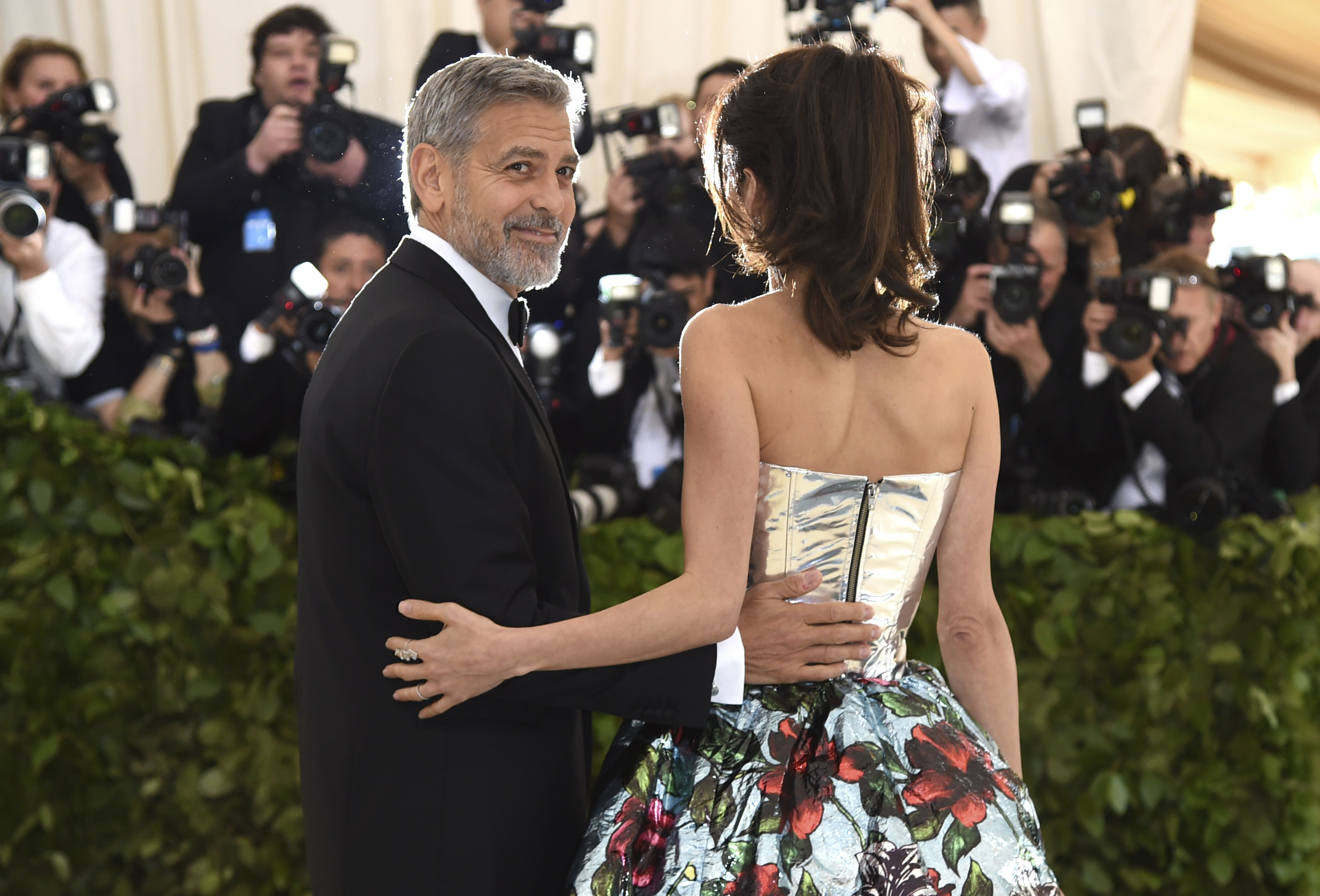 "<div class=""meta image-caption""><div class=""origin-logo origin-image ap""><span>AP</span></div><span class=""caption-text"">George Clooney, left, and Amal Clooney. (Photo by Evan Agostini/Invision/AP) (Evan Agostini/Invision/AP)</span></div>"