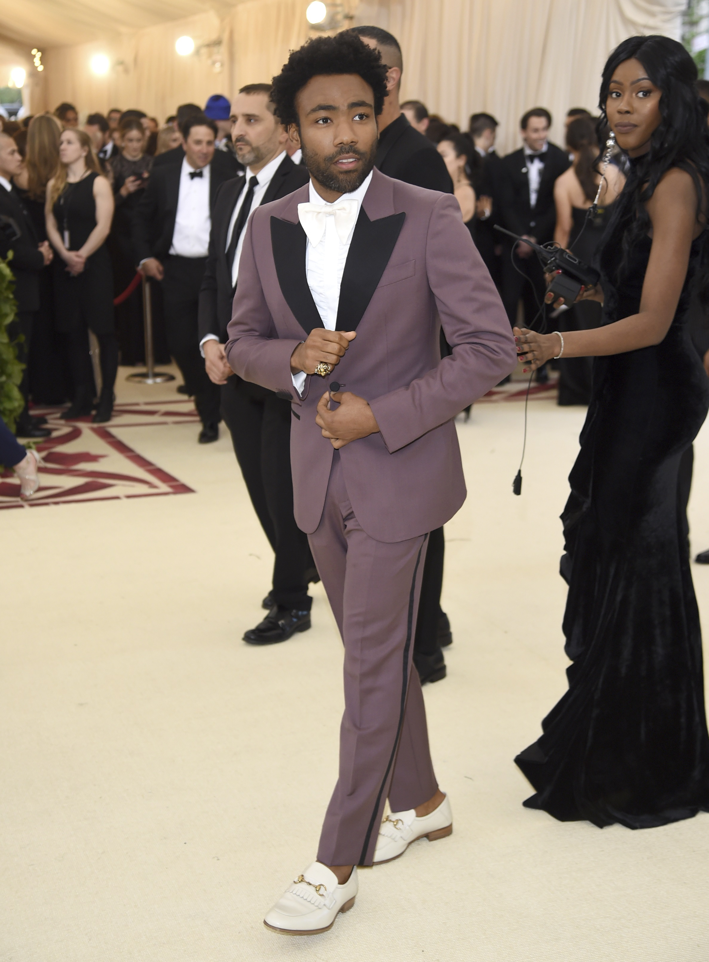 <div class='meta'><div class='origin-logo' data-origin='none'></div><span class='caption-text' data-credit='Evan Agostini/Invision/AP'>Childish Gambino (Photo by Evan Agostini/Invision/AP)</span></div>