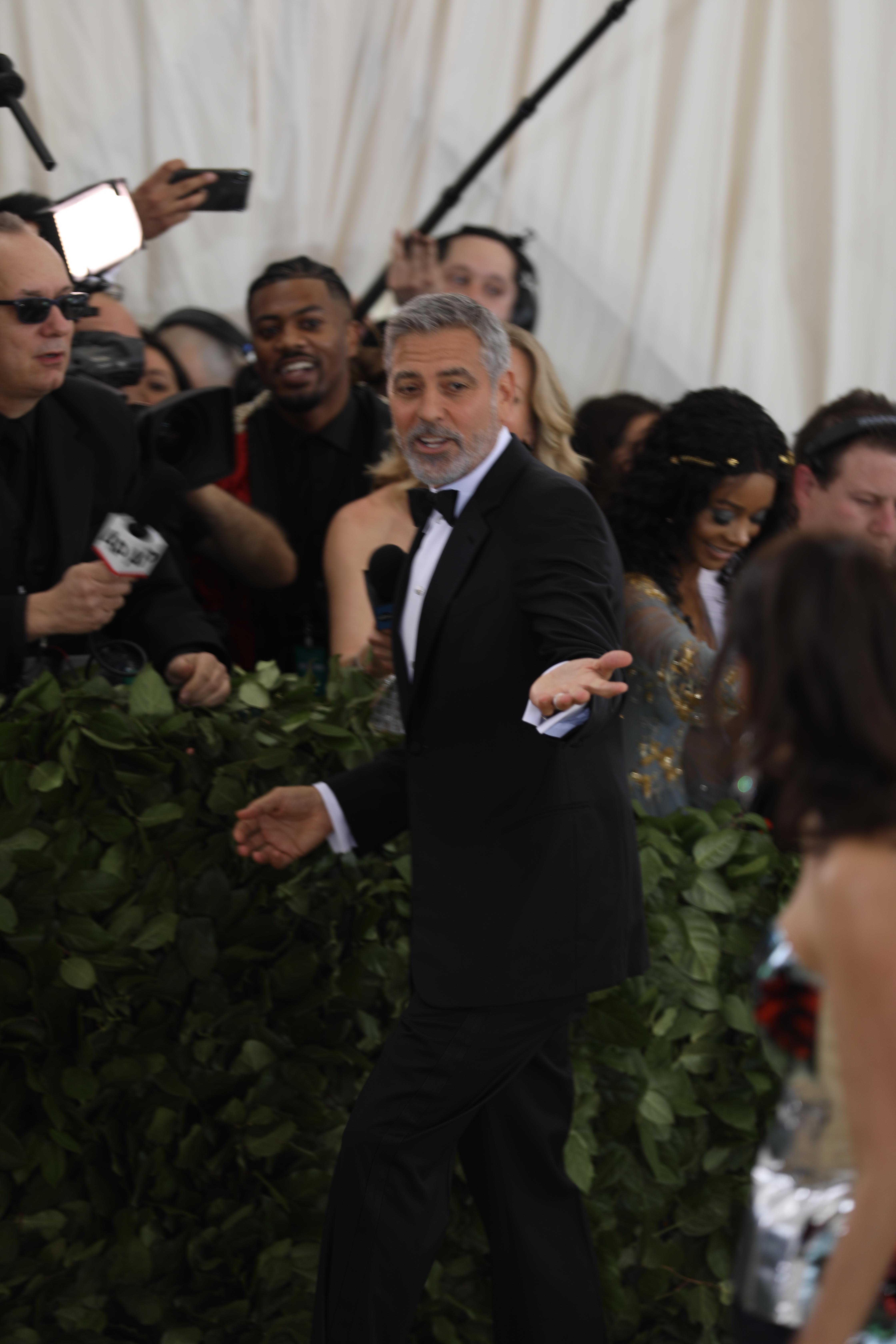 <div class='meta'><div class='origin-logo' data-origin='none'></div><span class='caption-text' data-credit='Emily Sowa (WABC)'>George Clooney</span></div>