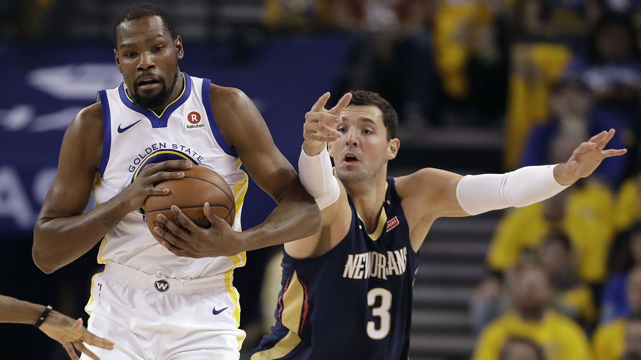 Golden State Warriors' Kevin Durant, left, is defended by New Orleans Pelicans' Nikola Mirotic during Game 5 Tuesday, May 8, 2018, in Oakland, Calif.
