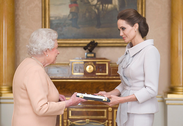 """<div class=""""meta image-caption""""><div class=""""origin-logo origin-image """"><span></span></div><span class=""""caption-text"""">Queen Elizabeth II made Angelina Jolie an honorary dame Friday, Oct. 10, 2014, for her work against sexual violence in war zones and her services to British foreign policy. (AP Photo/Anthony Devlin)</span></div>"""