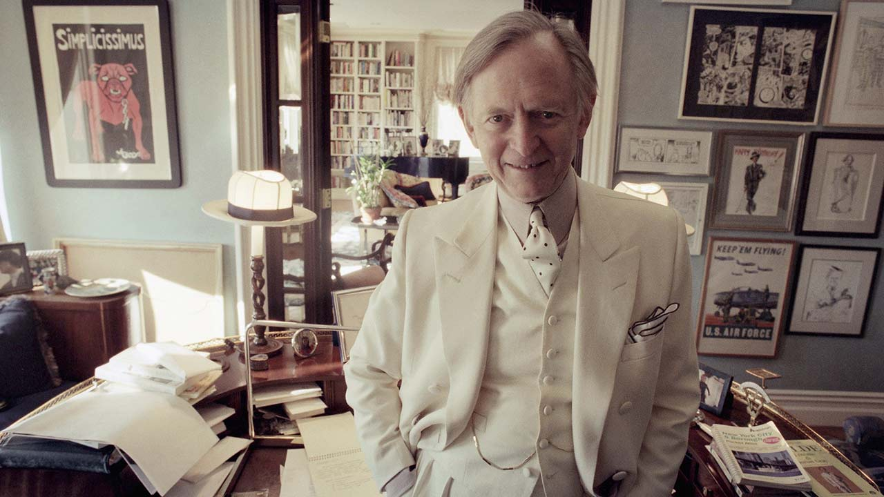 "Author Tom Wolfe poses in his New York apartment, Nov. 12, 1998. Wolfe, 68, just published his first novel in 11 years, a novel about Atlanta in the 1990s called ""A Man in Full."""