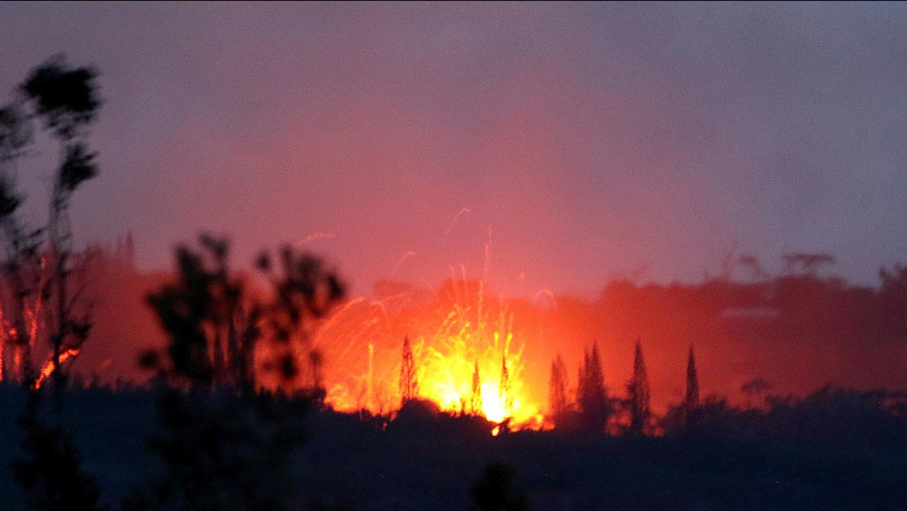 Lava shoots into the night sky from active fissures on the lower east rift of the Kilauea volcano, Tuesday, May 15, 2018, near Pahoa, Hawaii.