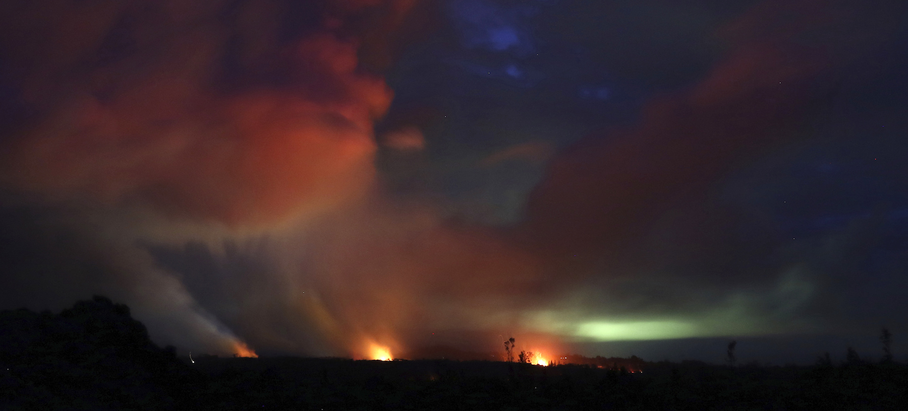 <div class='meta'><div class='origin-logo' data-origin='AP'></div><span class='caption-text' data-credit='AP Photo/Caleb Jones'>Lava shoots into the night sky from active fissures on the lower east rift of Kilauea volcano, Tuesday, May 15, 2018 near Pahoa, Hawaii.</span></div>