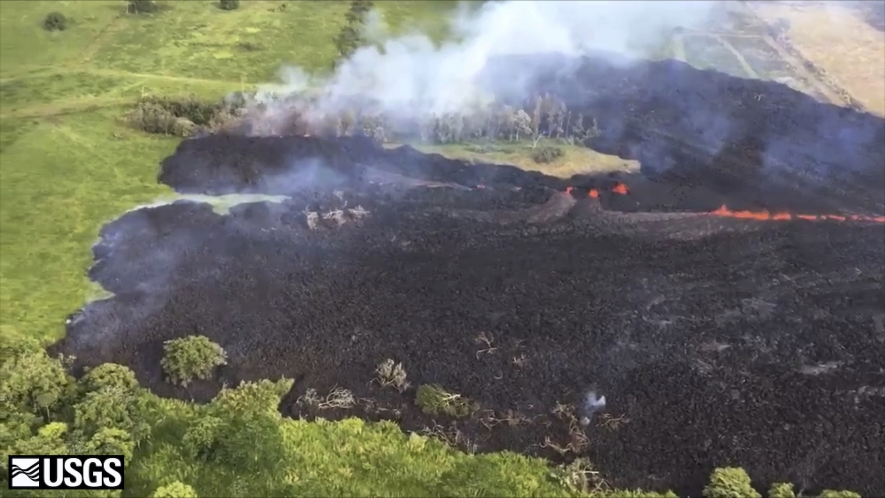 "<div class=""meta image-caption""><div class=""origin-logo origin-image ap""><span>AP</span></div><span class=""caption-text"">In this May 13, 2018 frame from video released by the U.S. Geological Survey, gases rise from a fissure near Pahoa, Hawaii. (U.S. Geological Survey via AP)</span></div>"
