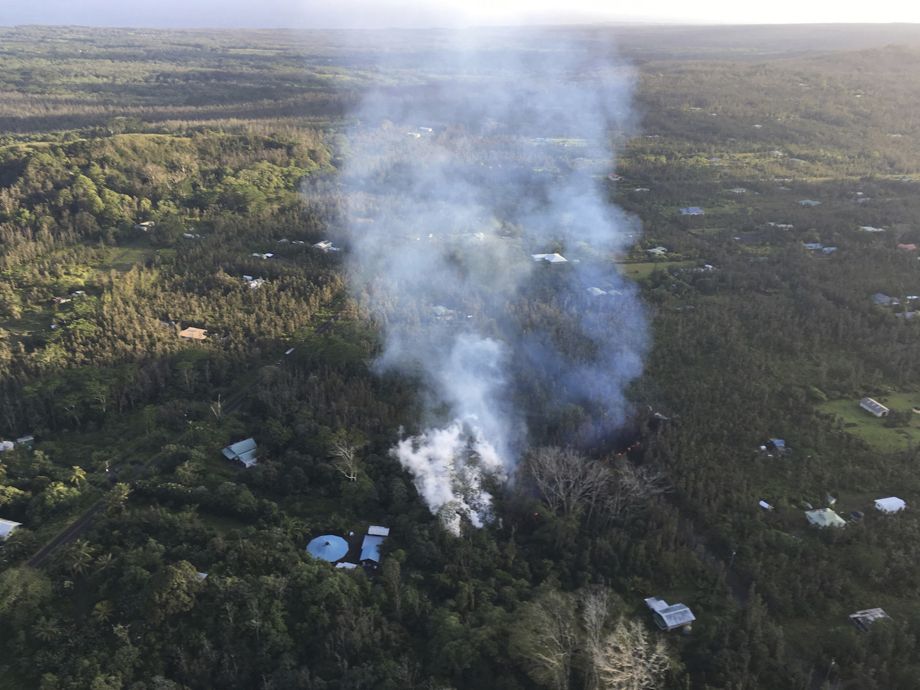 "<div class=""meta image-caption""><div class=""origin-logo origin-image ap""><span>AP</span></div><span class=""caption-text"">Lava is shown burning in Leilani Estates subdivision near the town of Pahoa on Hawaii'€™s Big Island. (USGS/AP)</span></div>"