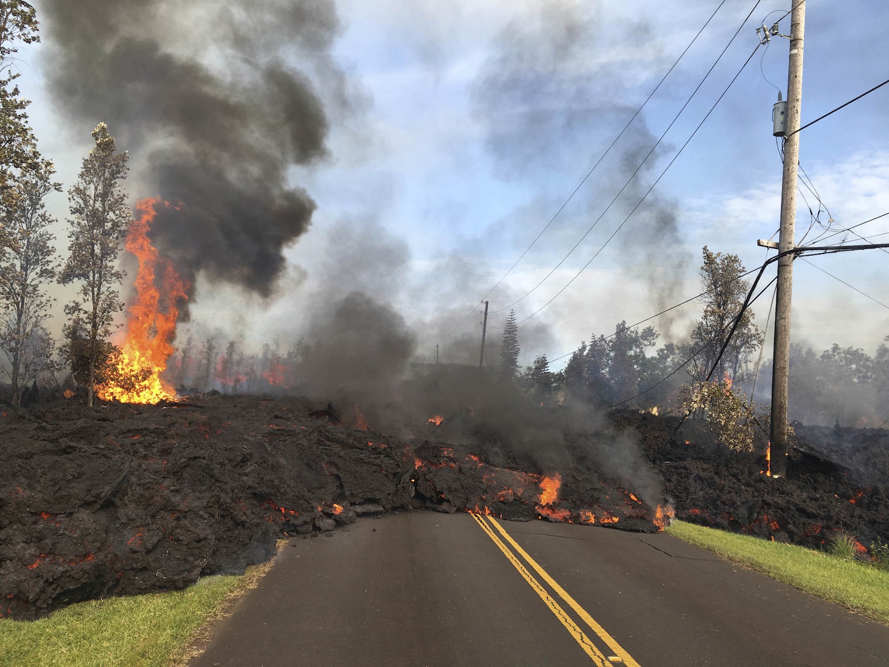 "<div class=""meta image-caption""><div class=""origin-logo origin-image ap""><span>AP</span></div><span class=""caption-text"">This Saturday, May 5, 2018, photo shows lava from fissure 7 slowly advancing to the northeast on Hookapu Street in Leilani Estates. (USGS/AP)</span></div>"