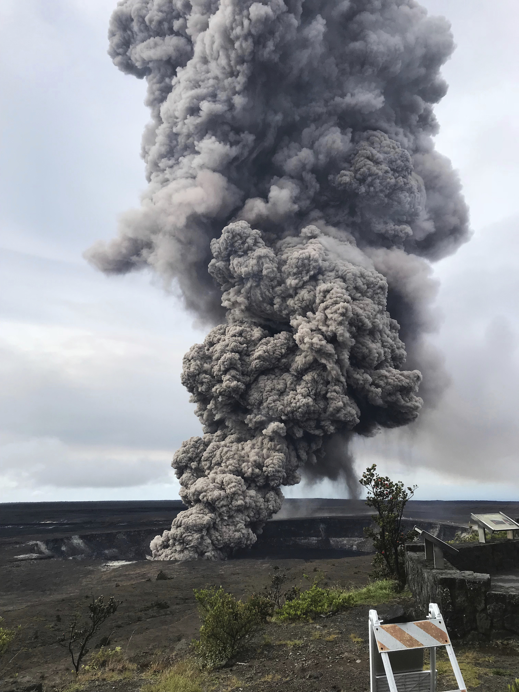 <div class='meta'><div class='origin-logo' data-origin='AP'></div><span class='caption-text' data-credit='USGS/AP'>In this Wednesday, May 9, 2018, photo, an ash column rises from the crater at the summit of Kilauea volcano at Volcanoes National Park, Hawaii.</span></div>