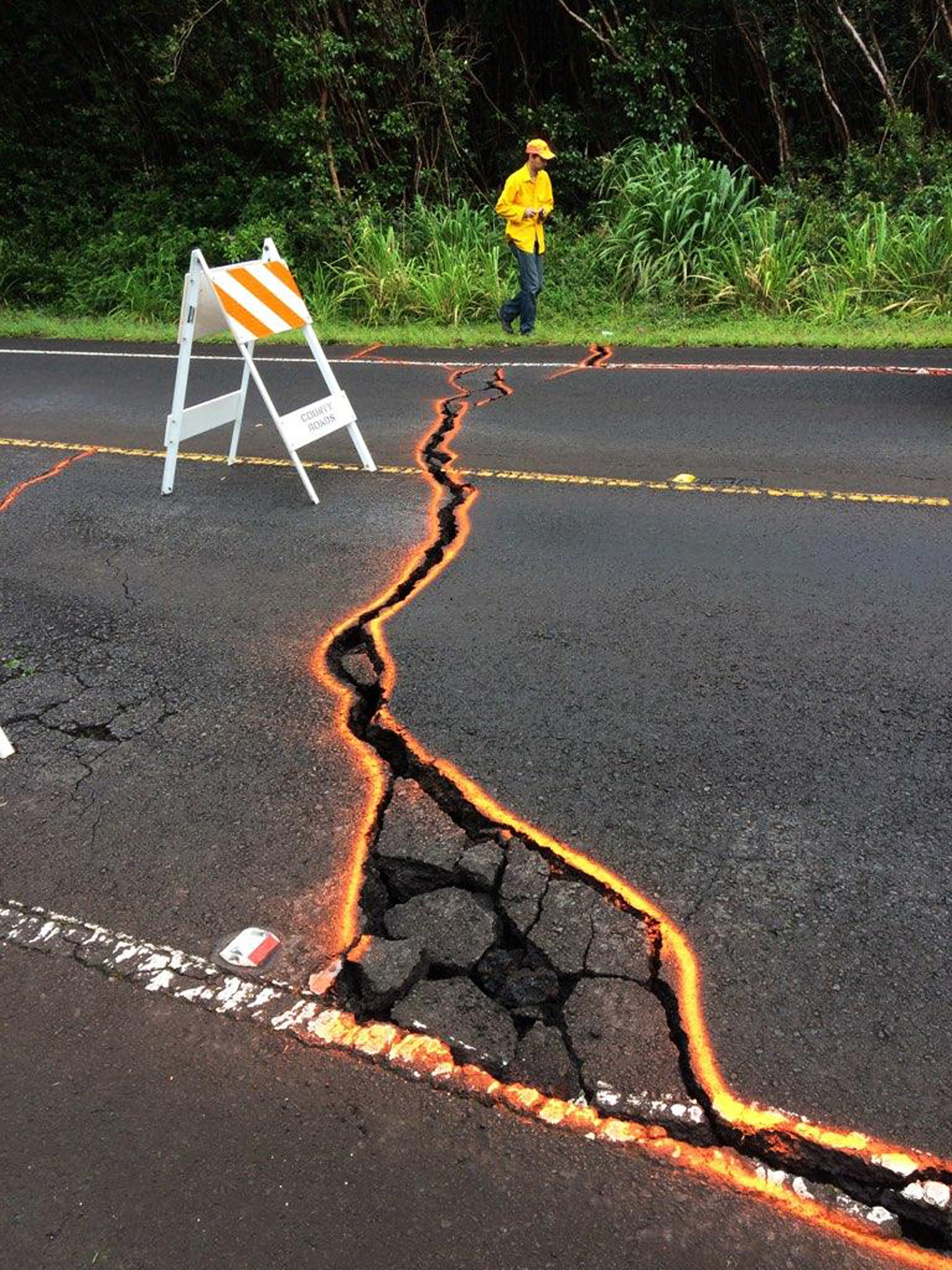 "<div class=""meta image-caption""><div class=""origin-logo origin-image ap""><span>AP</span></div><span class=""caption-text"">This Monday, May 7, 2018, photo from the U.S. Geological Survey shows cracks in Highway 130, outlined on orange paint, in the Leilani Estates subdivision. (USGS/AP)</span></div>"