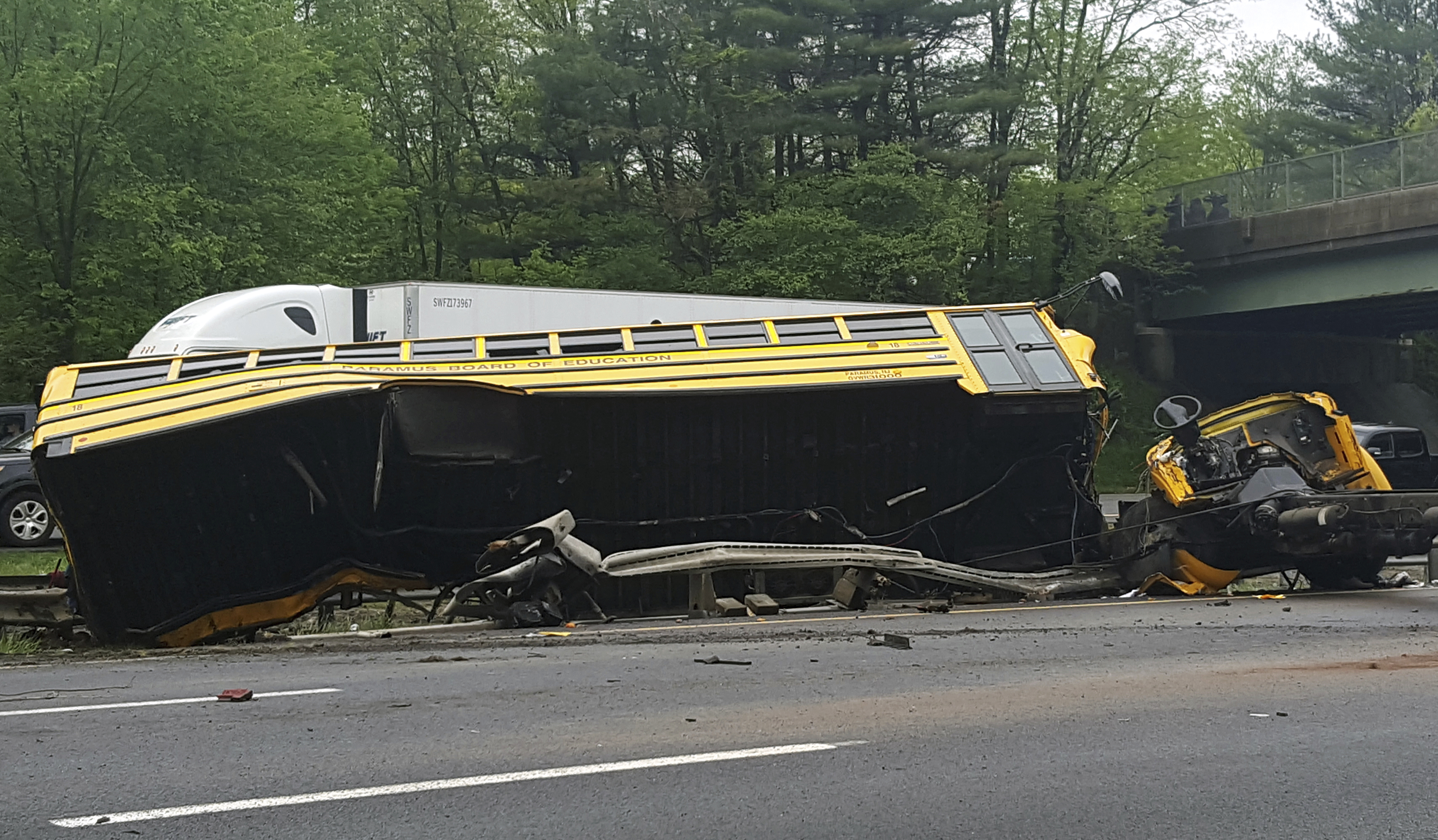 <div class='meta'><div class='origin-logo' data-origin='none'></div><span class='caption-text' data-credit='Chrissy Oleszek via AP'>This photo shows an overturned school bus after it collided with a dump truck, injuring multiple people, on Interstate 80 in Mount Olive, N.J., Thursday, May 17, 2018.</span></div>