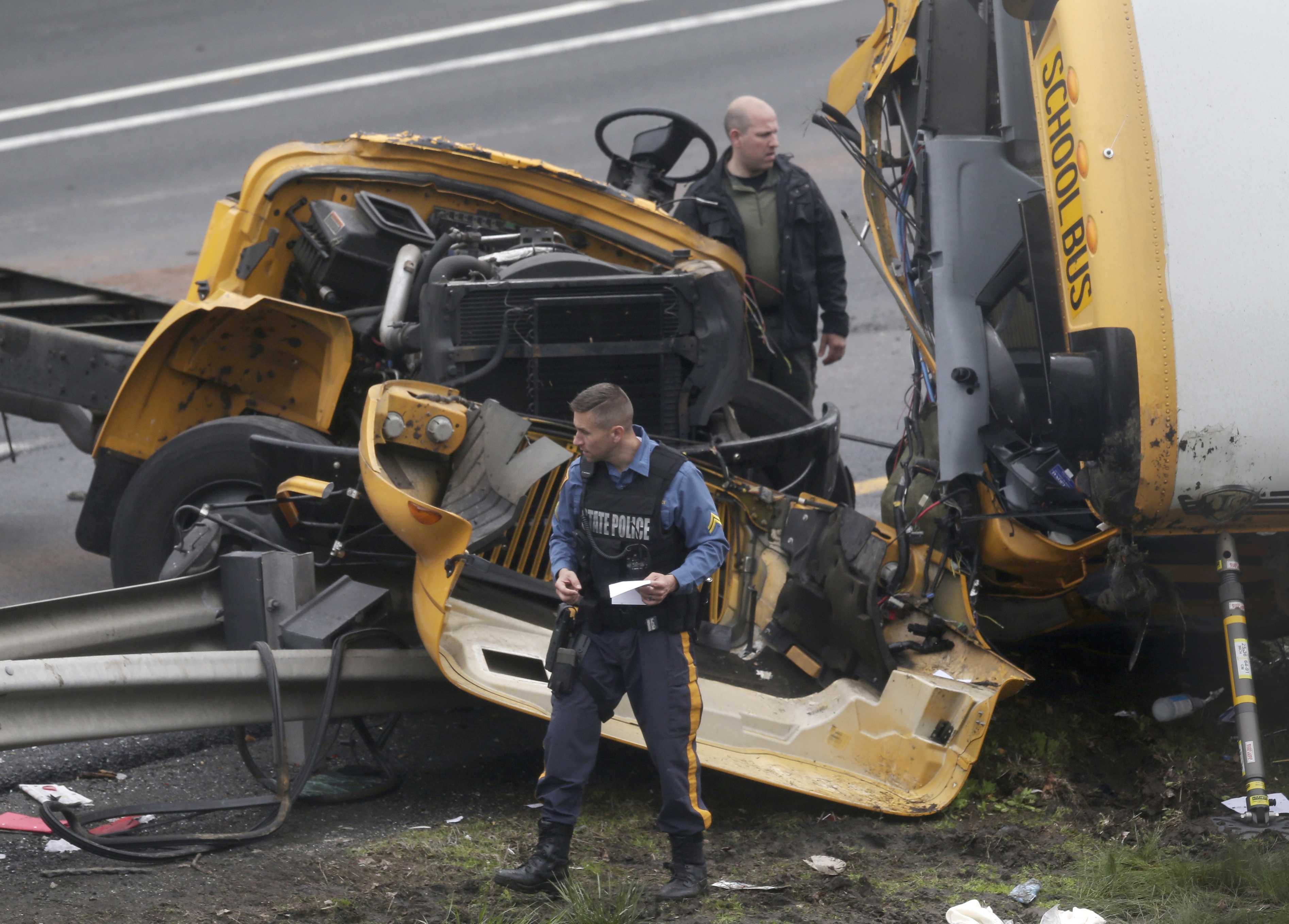 "<div class=""meta image-caption""><div class=""origin-logo origin-image none""><span>none</span></div><span class=""caption-text"">Emergency personnel work at the scene of a school bus and dump truck collision, injuring multiple people, on Interstate 80 in Mount Olive, N.J., Thursday, May 17, 2018. (AP Photo/Seth Wenig)</span></div>"