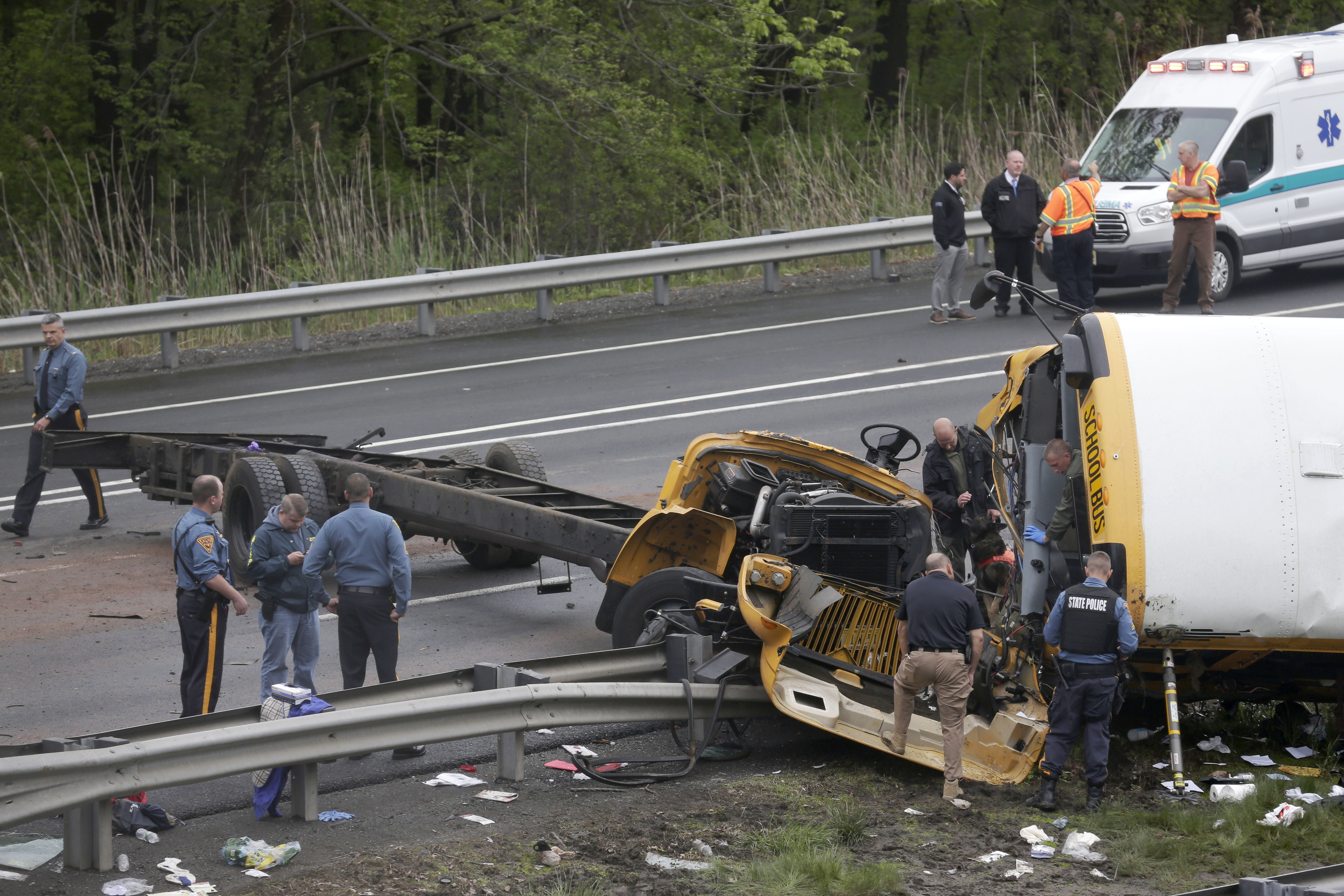 <div class='meta'><div class='origin-logo' data-origin='none'></div><span class='caption-text' data-credit='AP Photo/Seth Wenig'>Emergency personnel examine a school bus after it collided with a dump truck, injuring multiple people, on Interstate 80 in Mount Olive, N.J., Thursday, May 17, 2018.</span></div>
