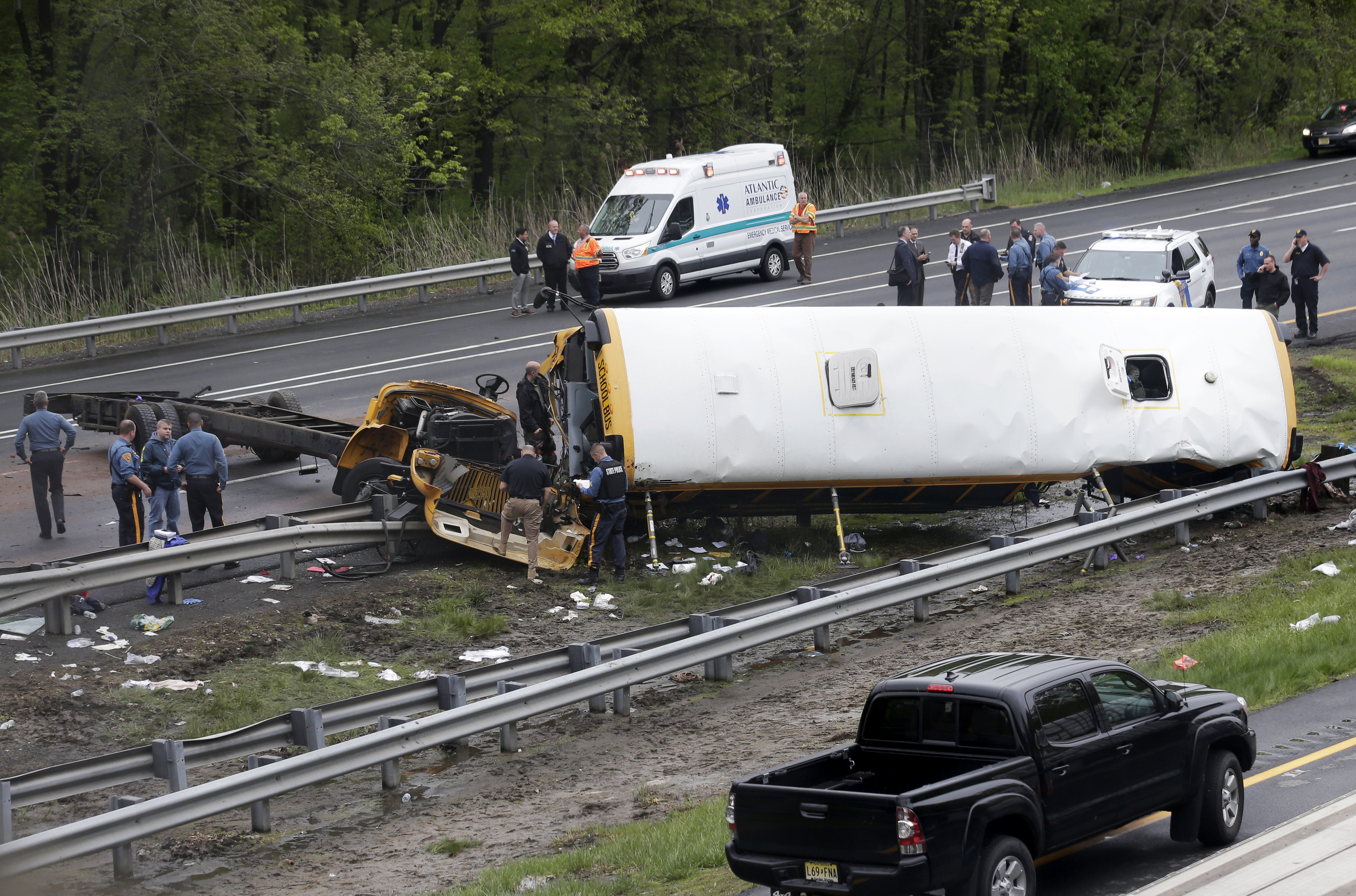 <div class='meta'><div class='origin-logo' data-origin='none'></div><span class='caption-text' data-credit='AP Photo/Seth Wenig'>Emergency personnel work at the scene of a school bus and dump truck collision, injuring multiple people, on Interstate 80 in Mount Olive, N.J., Thursday, May 17, 2018.</span></div>