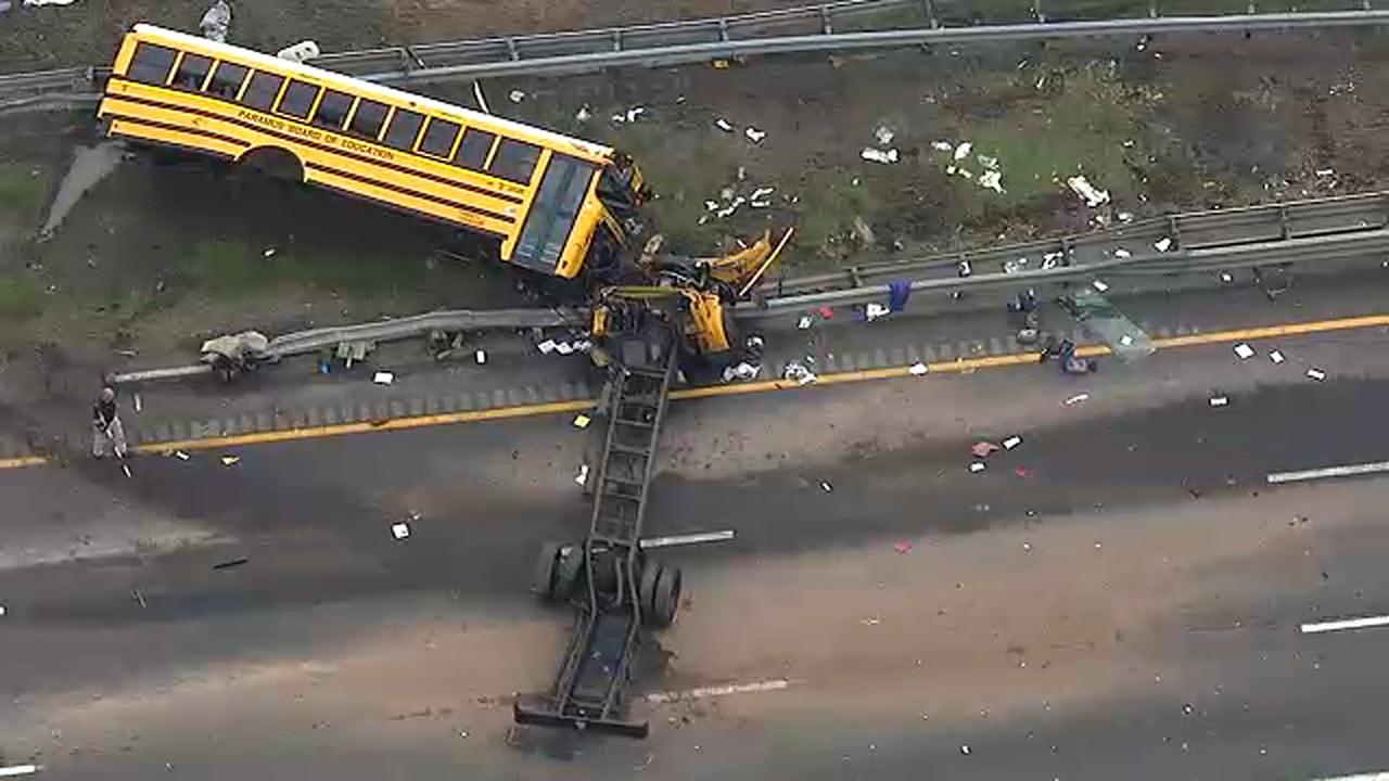 2 dead, dozens hurt when school bus collides with dump truck