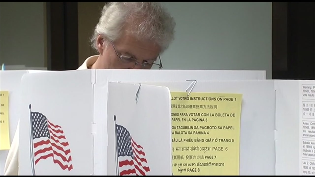 A person is seen voting in this undated image.