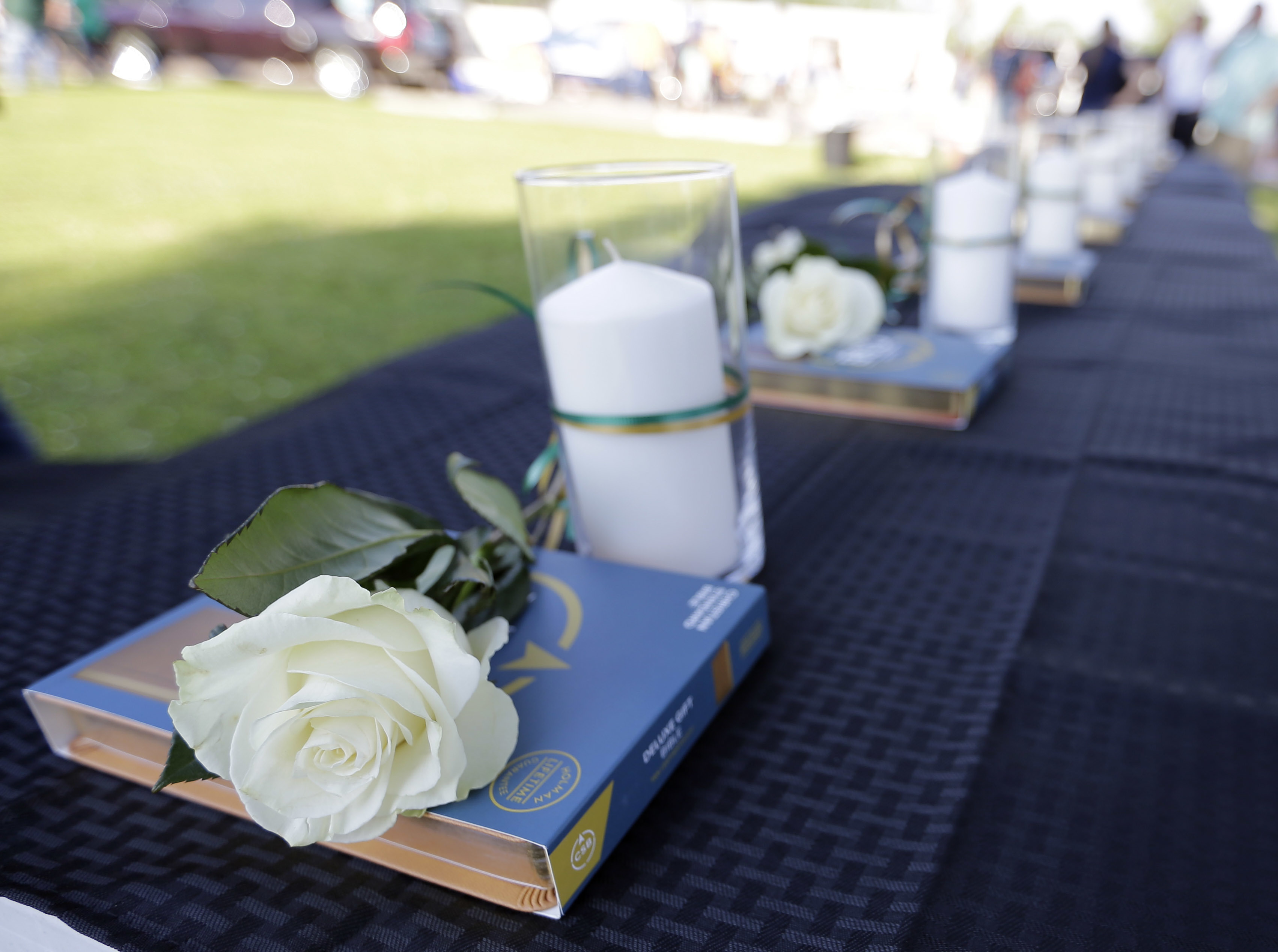 <div class='meta'><div class='origin-logo' data-origin='AP'></div><span class='caption-text' data-credit='AP'>Ten candles, roses and bibles are displayed on a table during a prayer vigil following a shooting at Santa Fe High School.<br> (AP Photo/David J. Phillip)</span></div>