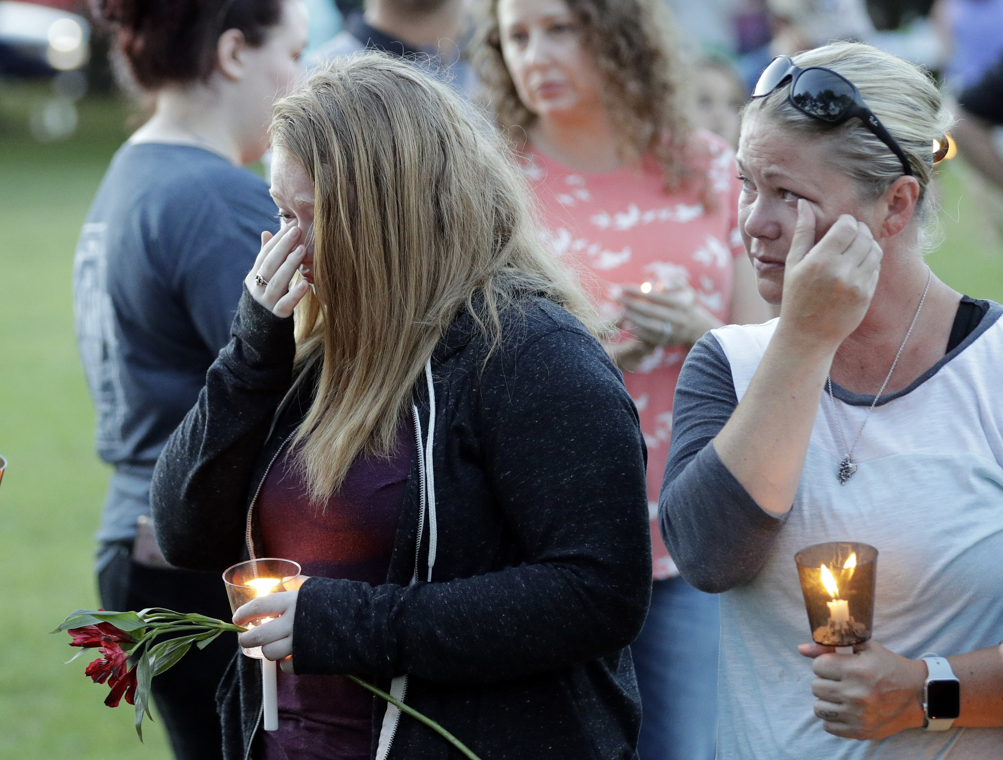 <div class='meta'><div class='origin-logo' data-origin='AP'></div><span class='caption-text' data-credit='AP'>Santa Fe High School freshman Kylie Trochesset, left, and her mother, Ashlee, wipe away tears during a prayer vigil. (AP Photo/David J. Phillip)</span></div>