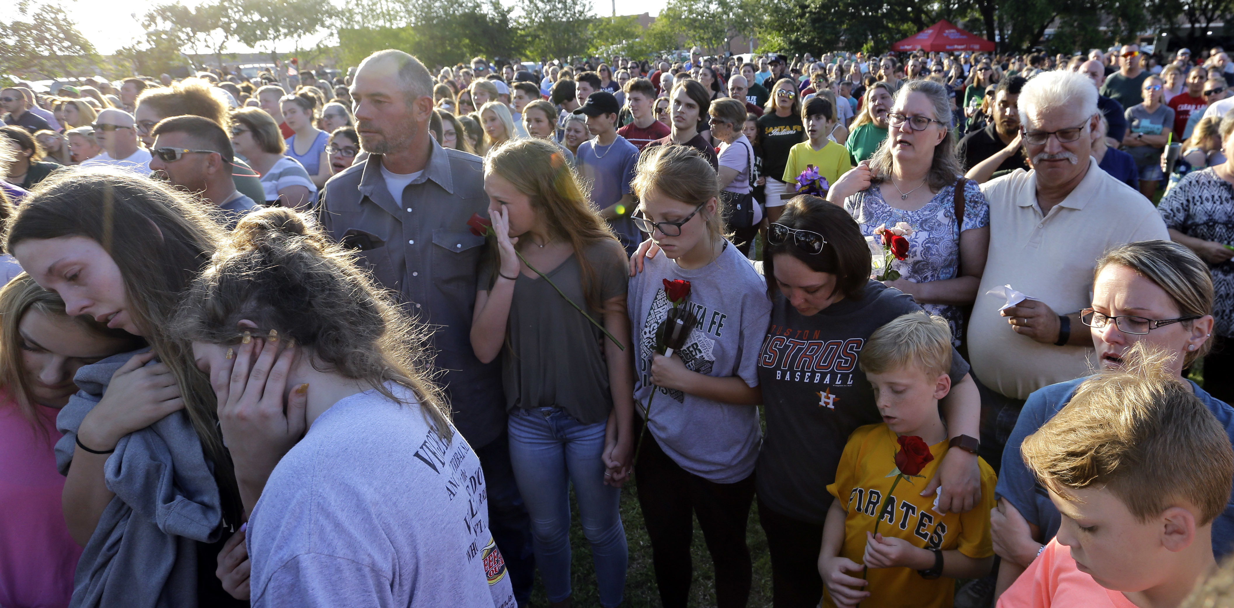 <div class='meta'><div class='origin-logo' data-origin='AP'></div><span class='caption-text' data-credit='AP'>Mourners gather during a prayer vigil following a shooting at Santa Fe High School in Santa Fe, Texas, on Friday, May 18, 2018. (AP Photo/David J. Phillip)</span></div>