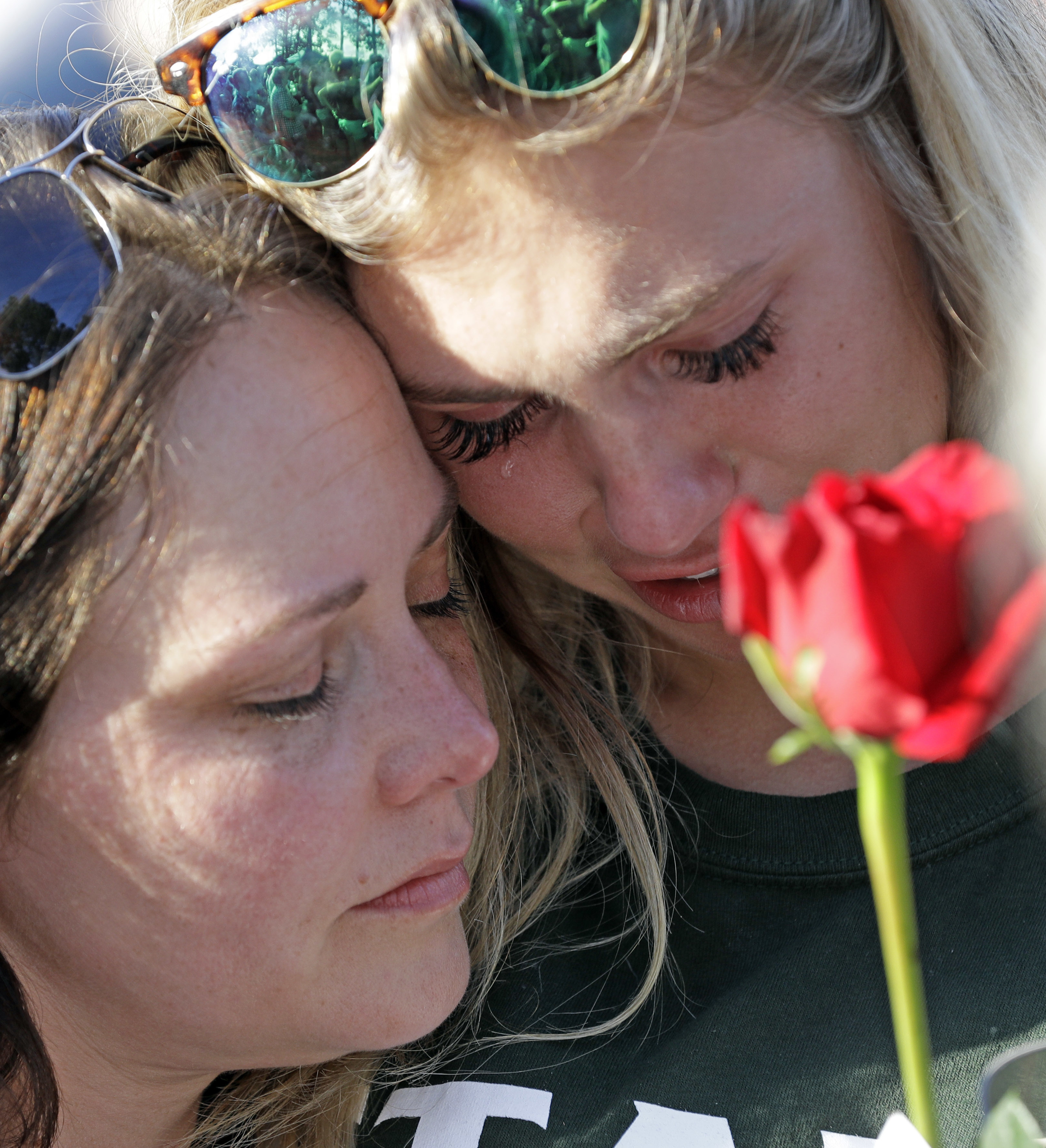 <div class='meta'><div class='origin-logo' data-origin='AP'></div><span class='caption-text' data-credit='AP'>Amy Nichols, left, comforts Santa Fe High School junior Paige Keenan during a prayer vigil following a shooting at Santa Fe High School.  (AP Photo/David J. Phillip)</span></div>