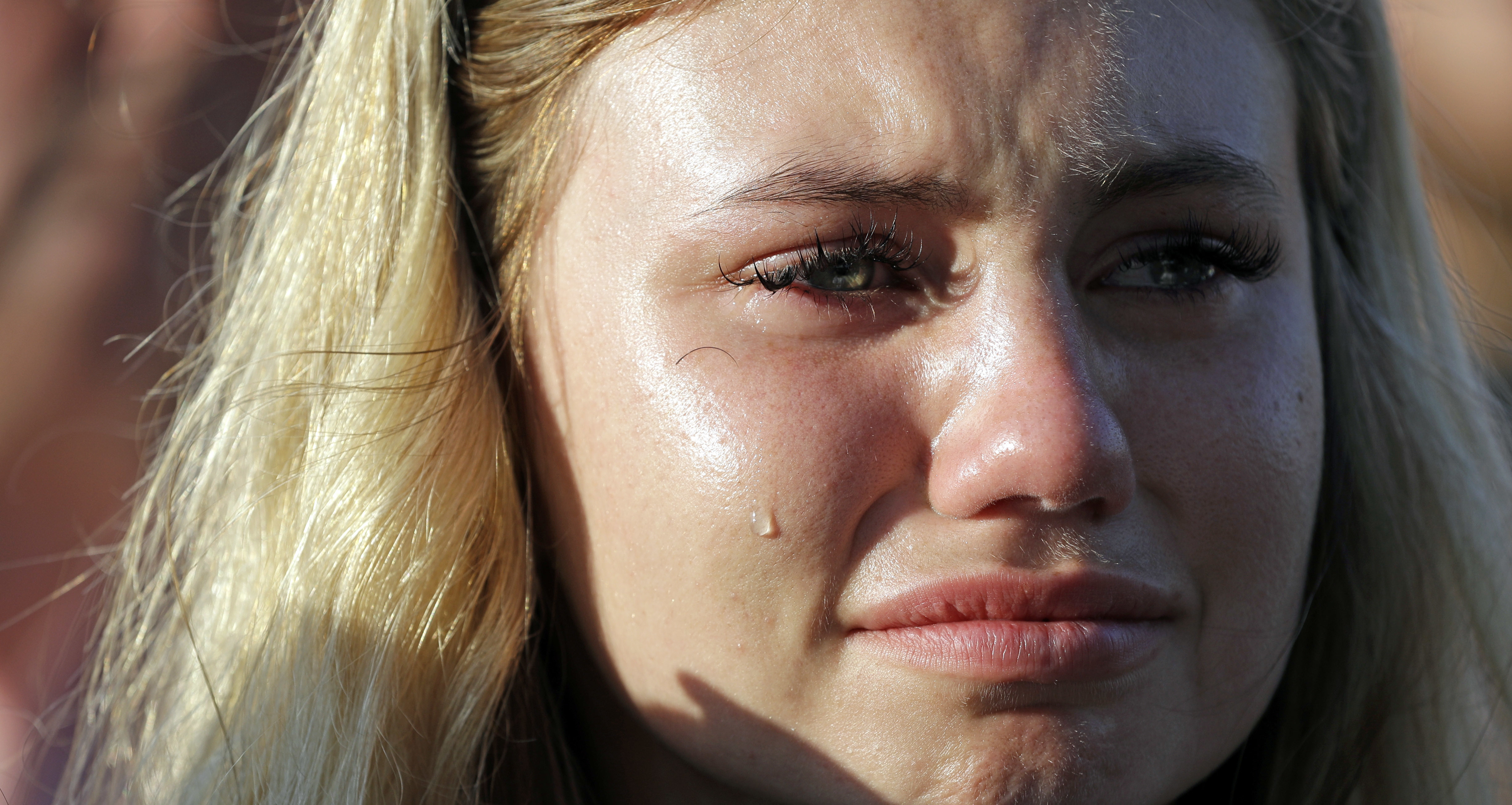 <div class='meta'><div class='origin-logo' data-origin='AP'></div><span class='caption-text' data-credit='AP'>A tear rolls down the face of Sante Fe High School junior Paige Keenan during a prayer vigil following a shooting at Santa Fe High School. (AP Photo/David J. Phillip)</span></div>
