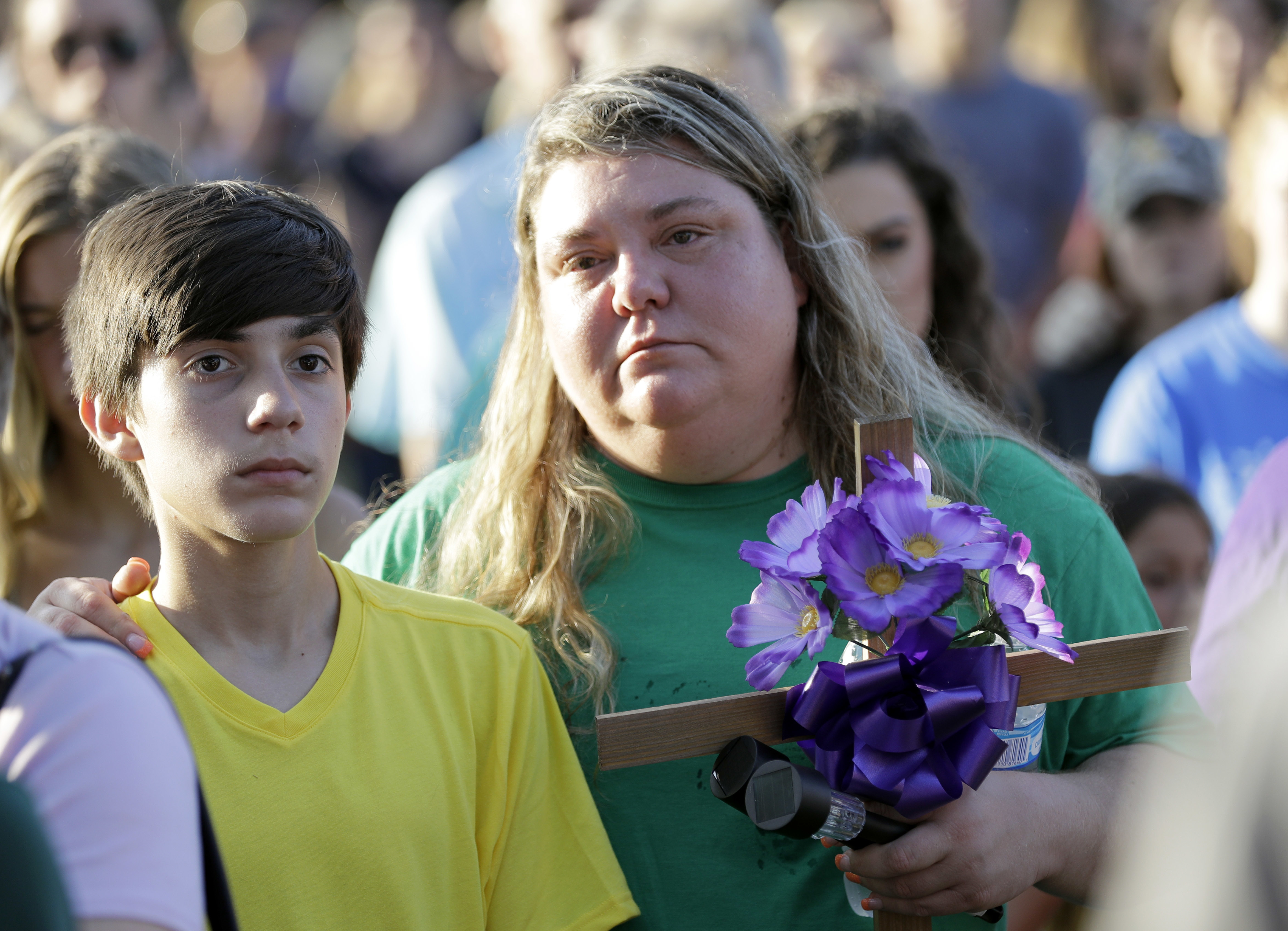 <div class='meta'><div class='origin-logo' data-origin='AP'></div><span class='caption-text' data-credit='AP'>Mourners listen during a prayer vigil following a shooting at Santa Fe High School in Santa Fe, Texas, on Friday, May 18, 2018.   (AP Photo/David J. Phillip)</span></div>