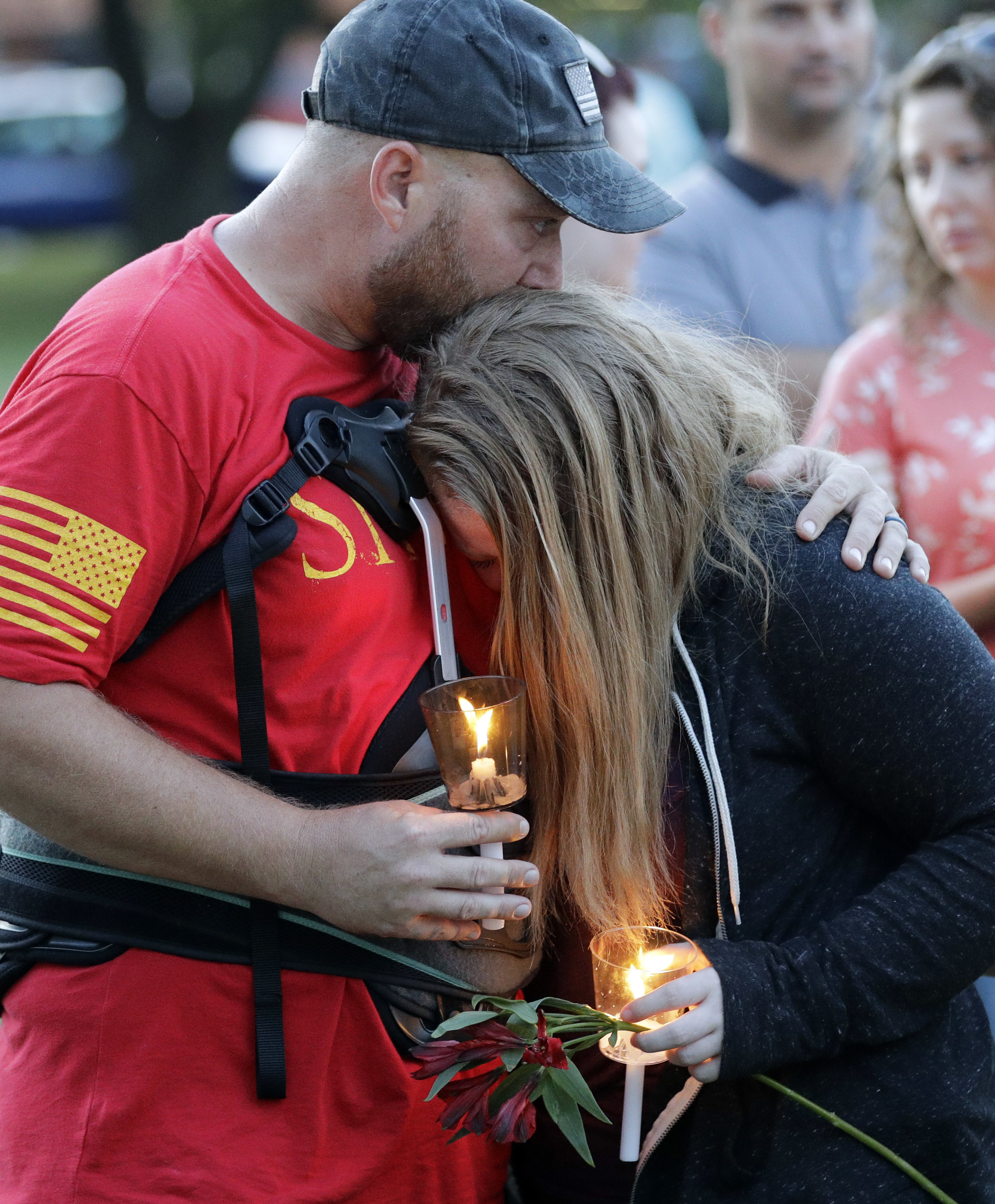 <div class='meta'><div class='origin-logo' data-origin='AP'></div><span class='caption-text' data-credit='AP'>Santa Fe High School freshman Kylie Trochesset, right, is comforted by her father, Jared, during a prayer vigil. (AP Photo/David J. Phillip)</span></div>