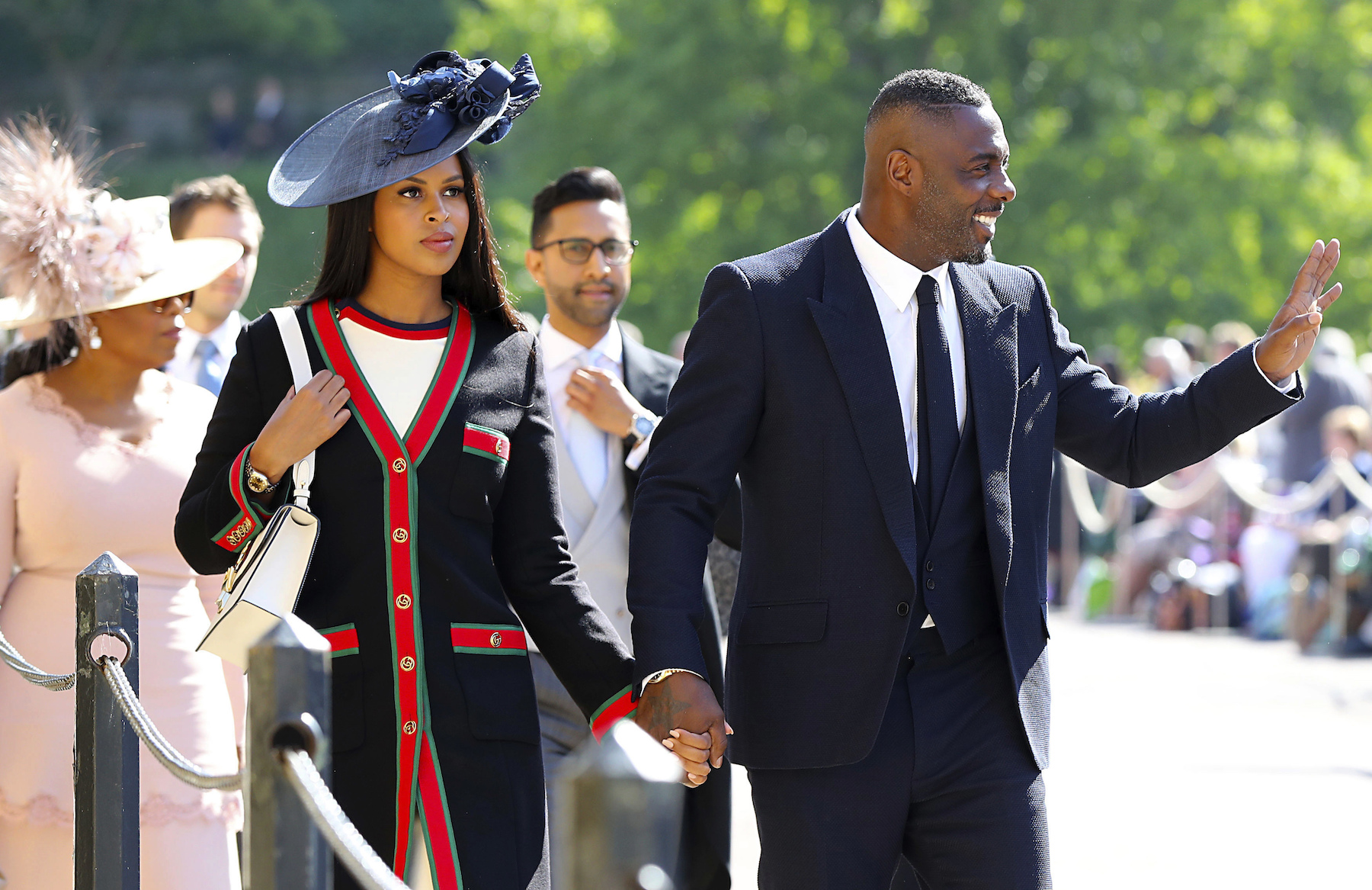 "<div class=""meta image-caption""><div class=""origin-logo origin-image ap""><span>AP</span></div><span class=""caption-text"">Idris Elba (right) and Sabrina Dhowre arrive at St George's Chapel at Windsor Castle for the wedding of Meghan Markle and Prince Harry. (Gareth Fuller/PA Wire)</span></div>"