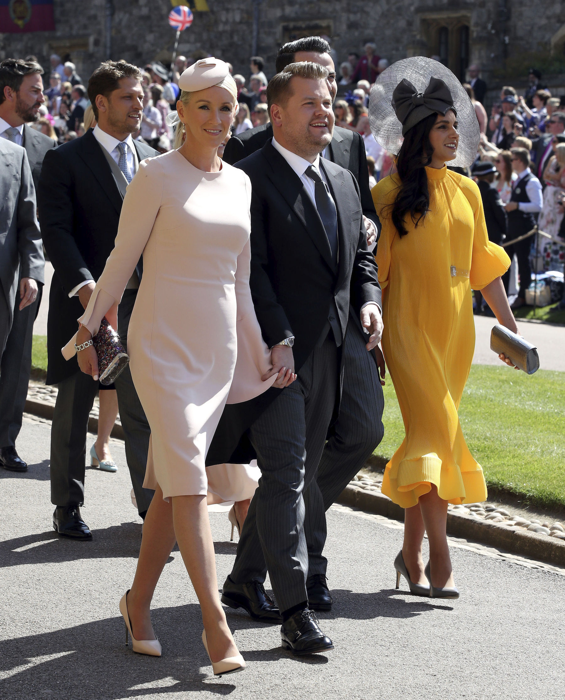 <div class='meta'><div class='origin-logo' data-origin='AP'></div><span class='caption-text' data-credit='Chris Radburn/PA Wire'>James Corden and Julia Carey arrive at St George's Chapel at Windsor Castle for the wedding of Meghan Markle and Prince Harry.</span></div>