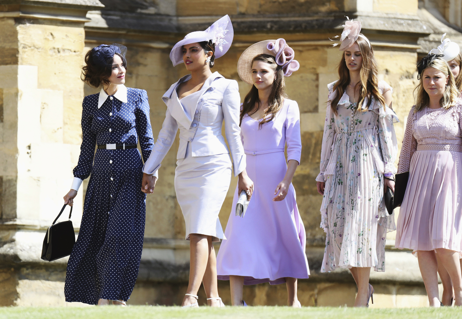 "<div class=""meta image-caption""><div class=""origin-logo origin-image ap""><span>AP</span></div><span class=""caption-text"">Abigail Spencer and Priyanka Chopra arrive at the wedding of Prince Harry to Ms Meghan Markle. (Chris Jackson/Getty Images)</span></div>"