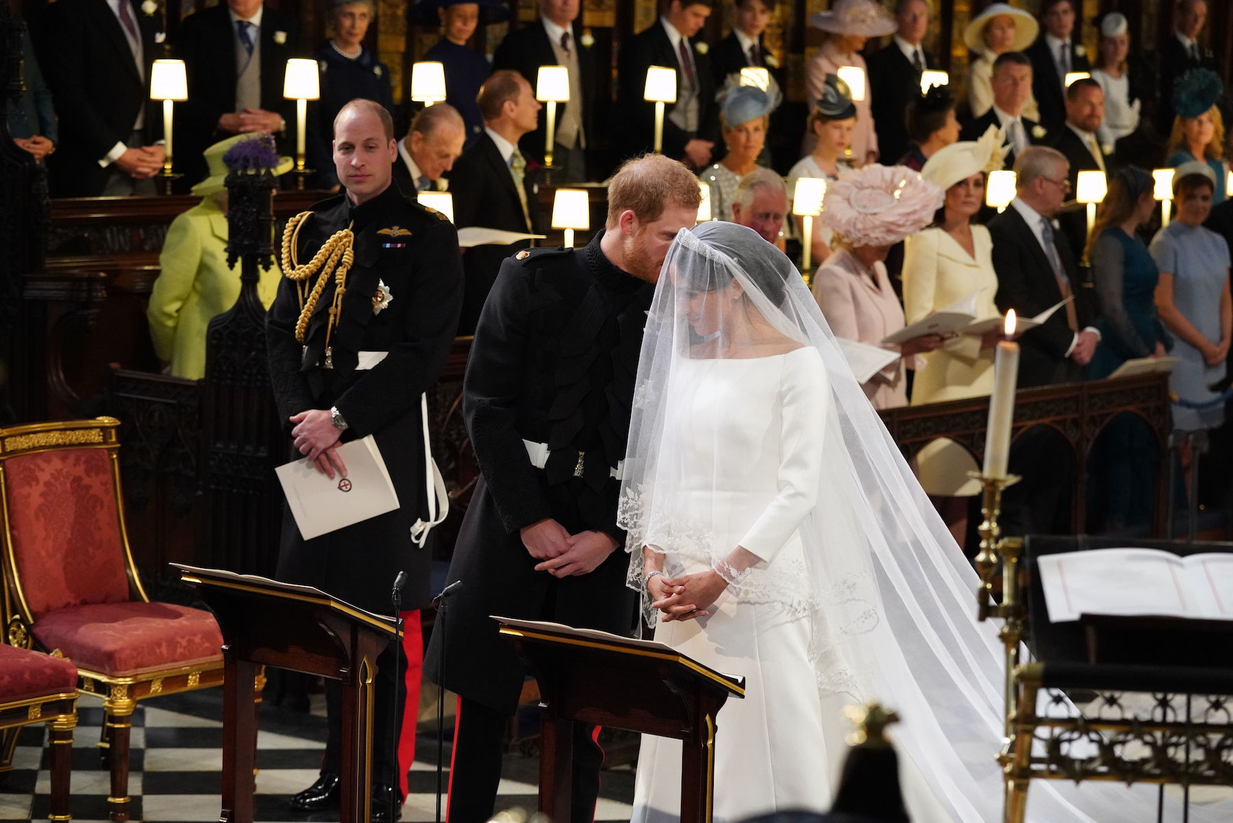 <div class='meta'><div class='origin-logo' data-origin='Creative Content'></div><span class='caption-text' data-credit='Jonathan BradyAFP/Getty Images'>Britain's Prince Harry and Meghan Markle arrive at the High Altar for their wedding ceremony in St George's Chapel, Windsor Castle.</span></div>