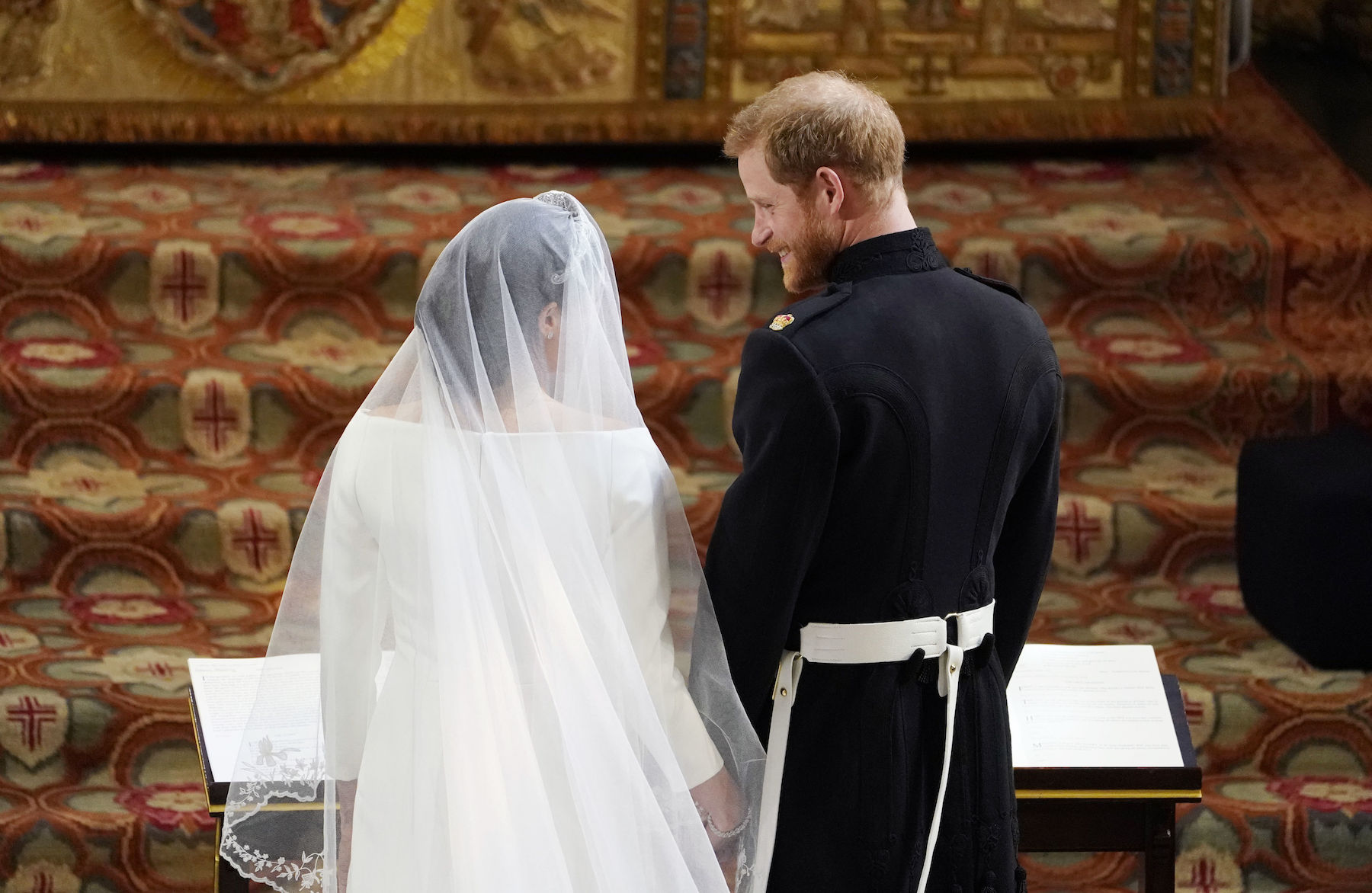 <div class='meta'><div class='origin-logo' data-origin='Creative Content'></div><span class='caption-text' data-credit='Owen Humphreys/AFP/Getty Images'>Britain's Prince Harry, Duke of Sussex (R) stands with US actress Meghan Markle (L) at the altar in St George's Chapel, Windsor Castle.</span></div>