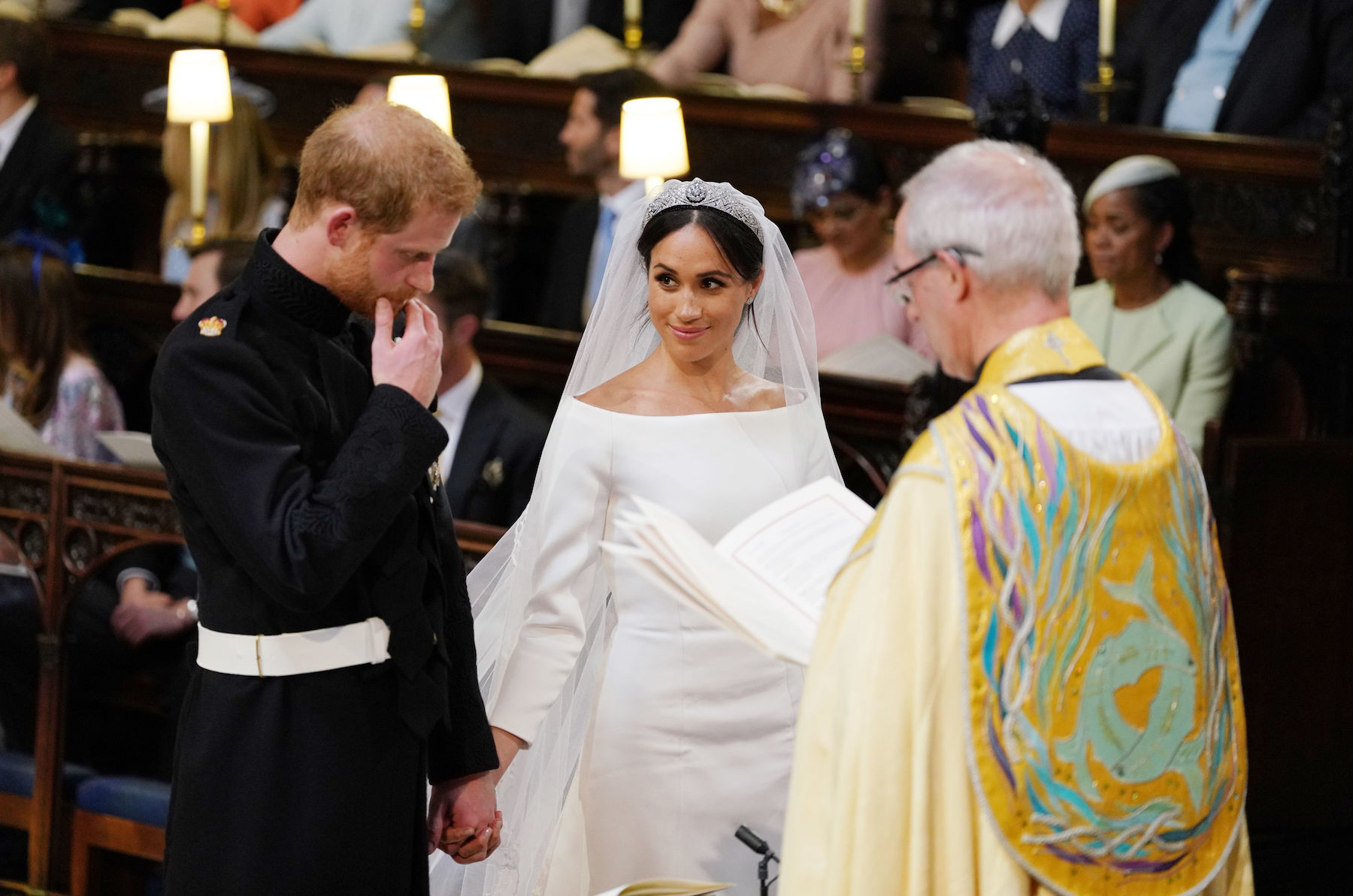 "<div class=""meta image-caption""><div class=""origin-logo origin-image wls""><span>wls</span></div><span class=""caption-text"">Prince Harry and Meghan Markle during their wedding service, conducted by the Archbishop of Canterbury Justin Welby in St George's Chapel. (WPA Pool/Getty Images)</span></div>"