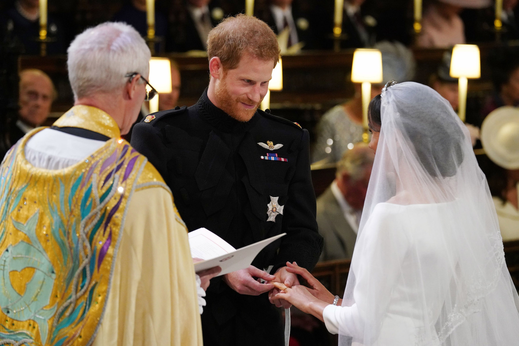 <div class='meta'><div class='origin-logo' data-origin='Creative Content'></div><span class='caption-text' data-credit='Jonathan Brady.Getty Images'>Prince Harry places the wedding ring on the finger of Meghan Markle during their wedding service, conducted by the Archbishop of Canterbury Justin Welby.</span></div>