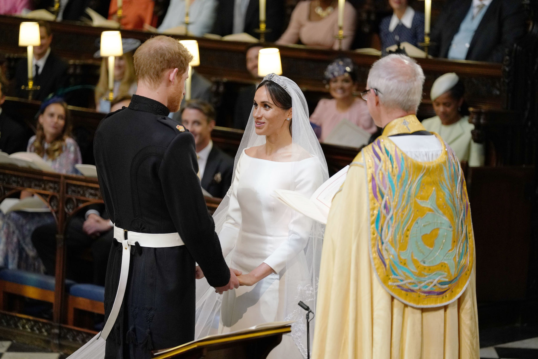 <div class='meta'><div class='origin-logo' data-origin='Creative Content'></div><span class='caption-text' data-credit='Dominic Lipinsky/AFP/Getty Images'>Britain's Prince Harry, Duke of Sussex, and US fiancee of Britain's Prince Harry Meghan Markle during their wedding ceremony in St George's Chapel.</span></div>