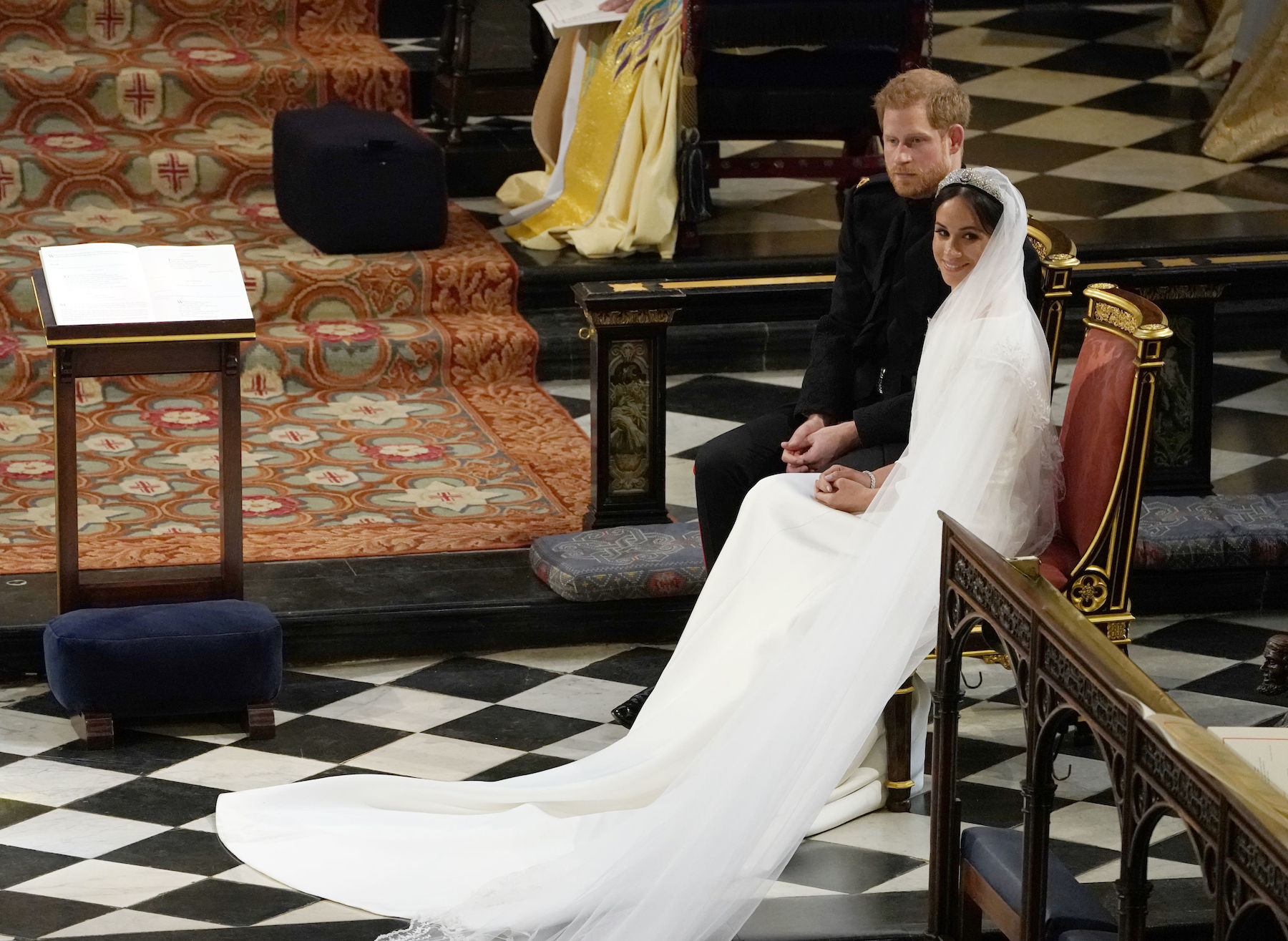 "<div class=""meta image-caption""><div class=""origin-logo origin-image kgo""><span>kgo</span></div><span class=""caption-text"">Britain's Prince Harry, Duke of Sussex (L) sits with US actress Meghan Markle (R) during the reading in St George's Chapel. (Owen Humphreys/AFP/Getty Images)</span></div>"