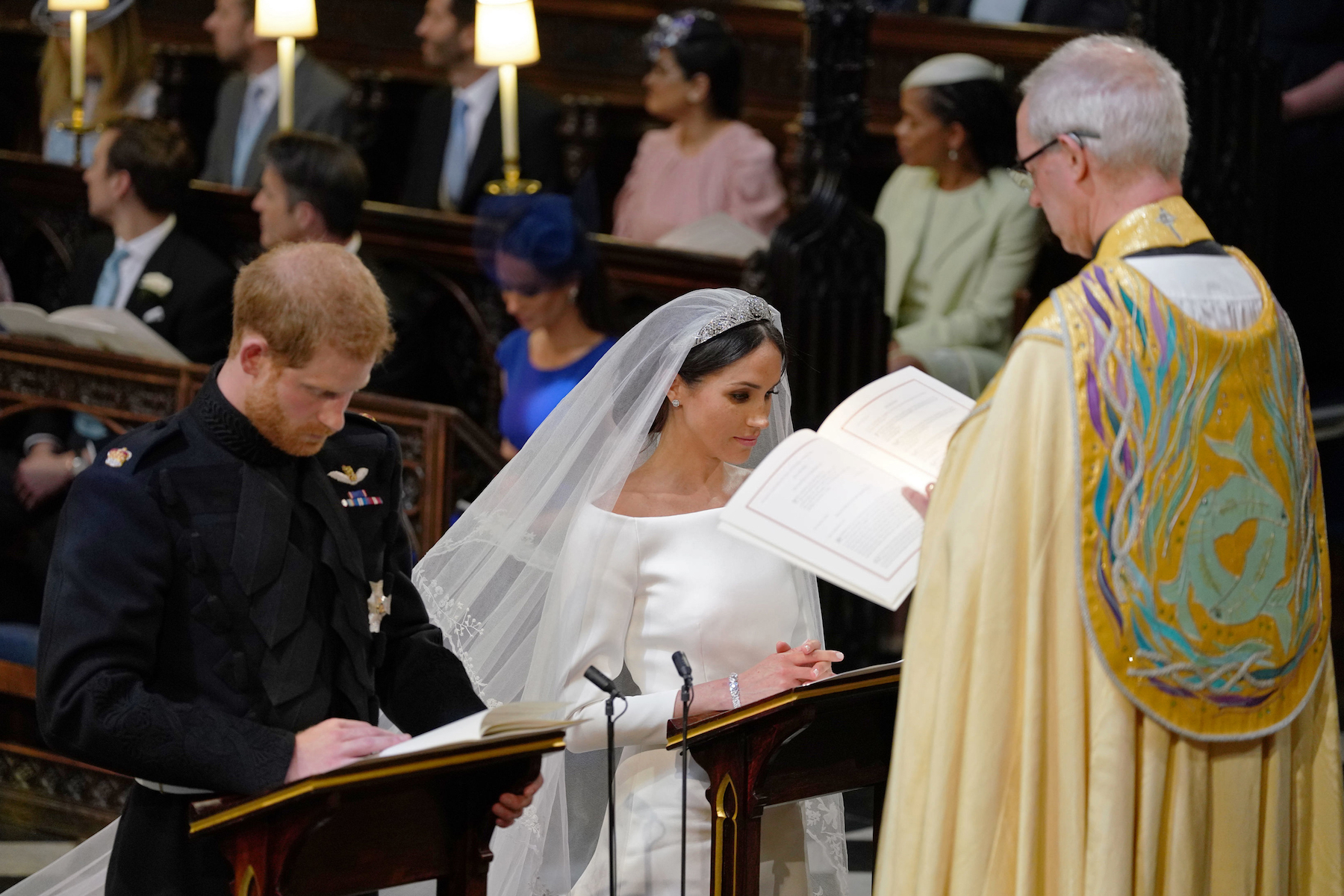 "<div class=""meta image-caption""><div class=""origin-logo origin-image wls""><span>wls</span></div><span class=""caption-text"">Britain's Prince Harry, Duke of Sussex (L) and US fiancee of Britain's Prince Harry Meghan Markle stand together at the High Altar. (Dominic Lipinsky/AFP/Getty Images)</span></div>"