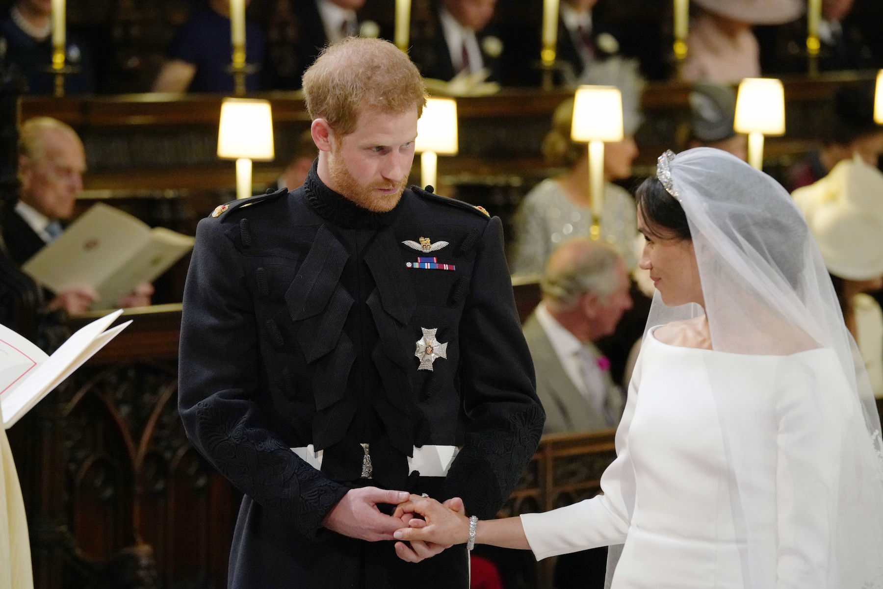 <div class='meta'><div class='origin-logo' data-origin='Creative Content'></div><span class='caption-text' data-credit='Jonathan Brady/AFP/Getty Images'>Britain's Prince Harry and Meghan Markle stand together hand in hand at the High Altar during their wedding ceremony in St George's Chapel.</span></div>