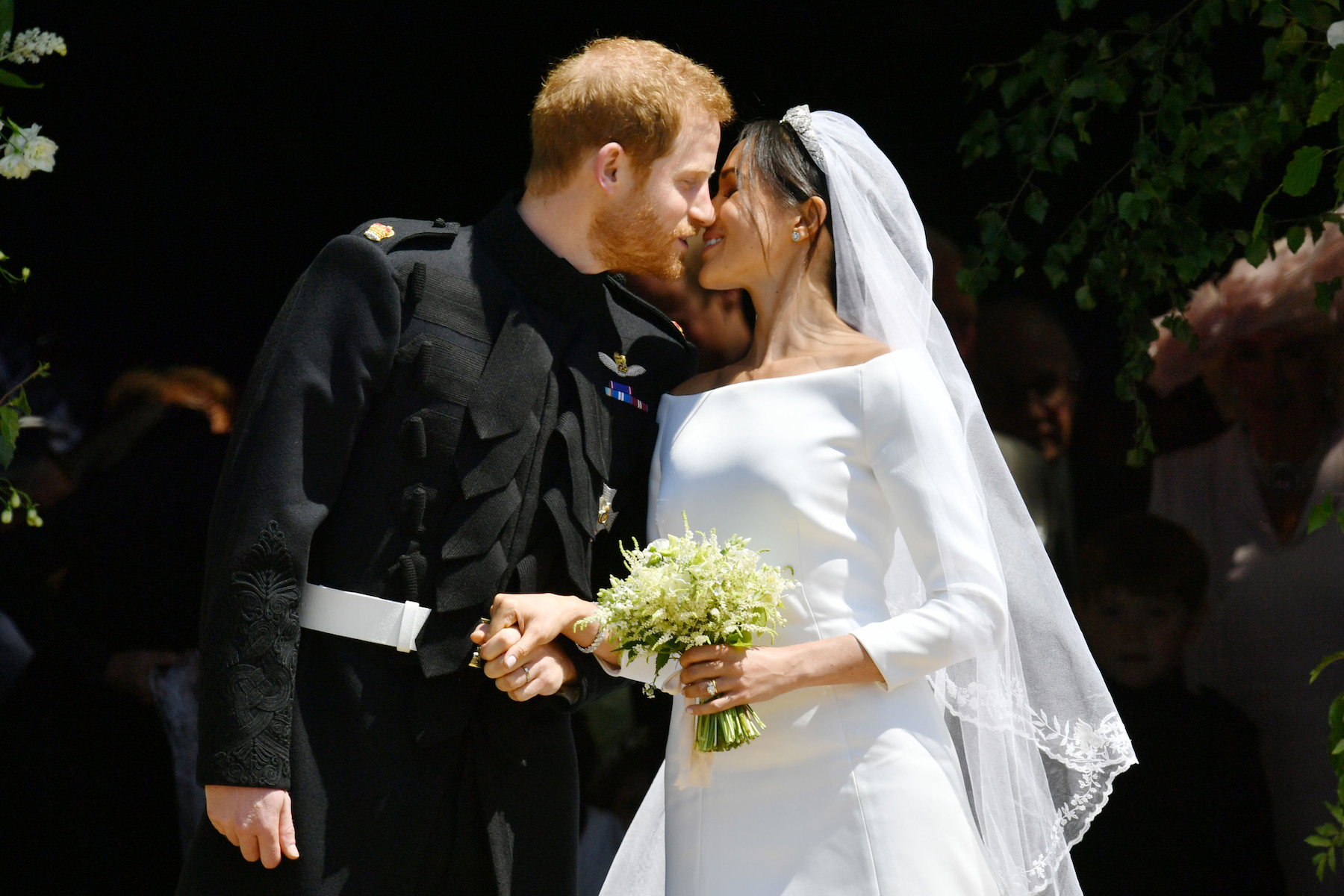 "<div class=""meta image-caption""><div class=""origin-logo origin-image kgo""><span>kgo</span></div><span class=""caption-text"">Britain's Prince Harry, Duke of Sussex kisses his wife Meghan, Duchess of Sussex as they leave from the West Door of St George's Chapel. (Ben Birchall/AFP/Getty Images)</span></div>"