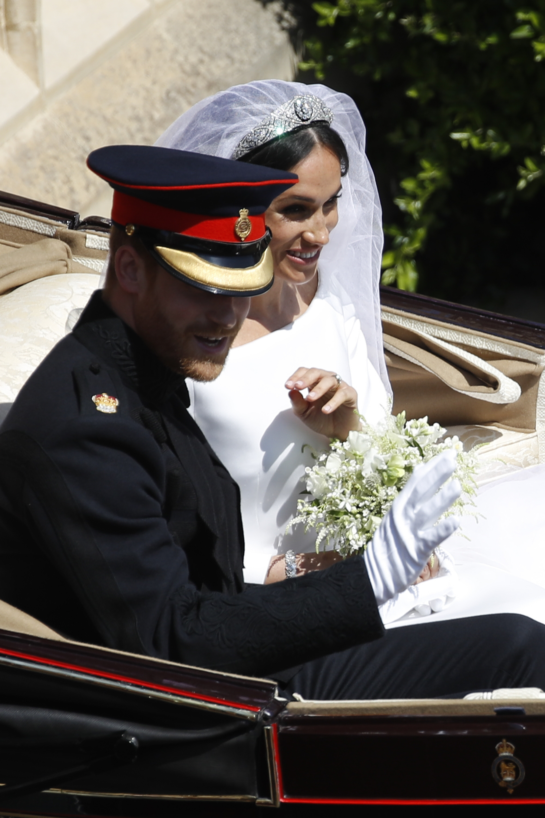 "<div class=""meta image-caption""><div class=""origin-logo origin-image ap""><span>AP</span></div><span class=""caption-text"">Britain's Prince Harry and Meghan Markle leave in a carriage after their wedding ceremony at St. George's Chapel in Windsor Castle in Windsor. (Odd Andersen/pool photo via AP)</span></div>"