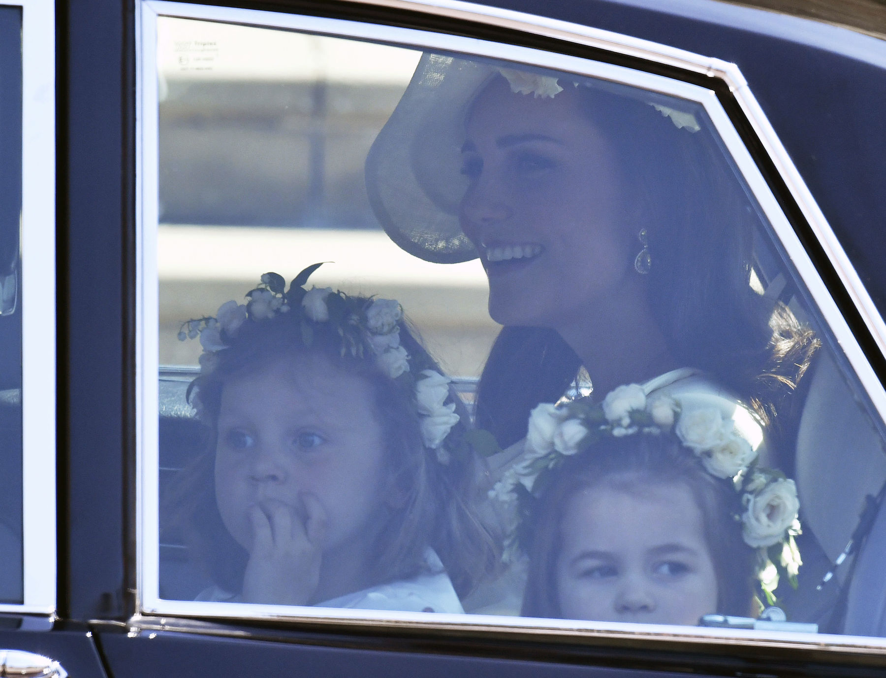 <div class='meta'><div class='origin-logo' data-origin='AP'></div><span class='caption-text' data-credit='Ben Birchhall/pool photo via AP'>Kate, Duchess of Cambridge arrives with the Princess Charlotte, right, for the wedding ceremony of Prince Harry and Meghan Markle at St. George's Chapel in Windsor Castle.</span></div>
