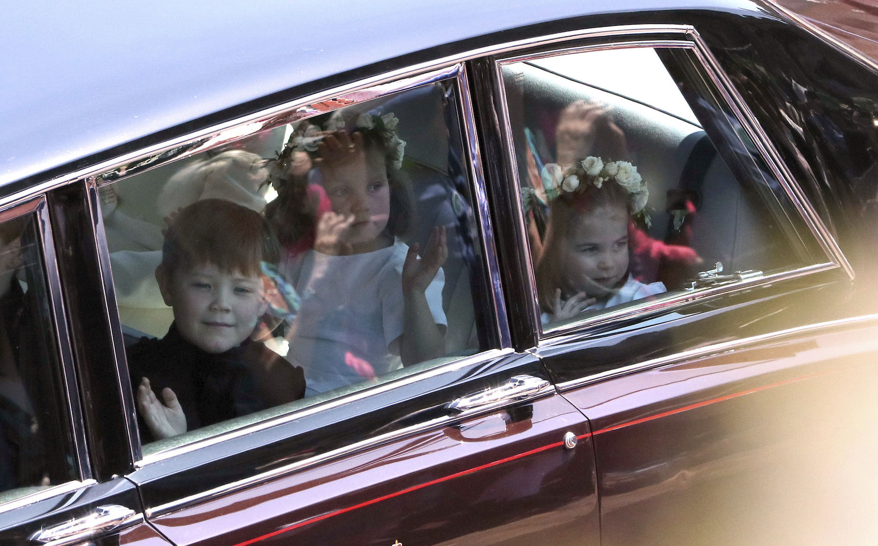 <div class='meta'><div class='origin-logo' data-origin='AP'></div><span class='caption-text' data-credit='Andrew Matthews/pool photo via AP'>Princess Charlotte, right, arrives for the wedding ceremony of Prince Harry and Meghan Markle at St. George's Chapel in Windsor Castle in Windsor.</span></div>
