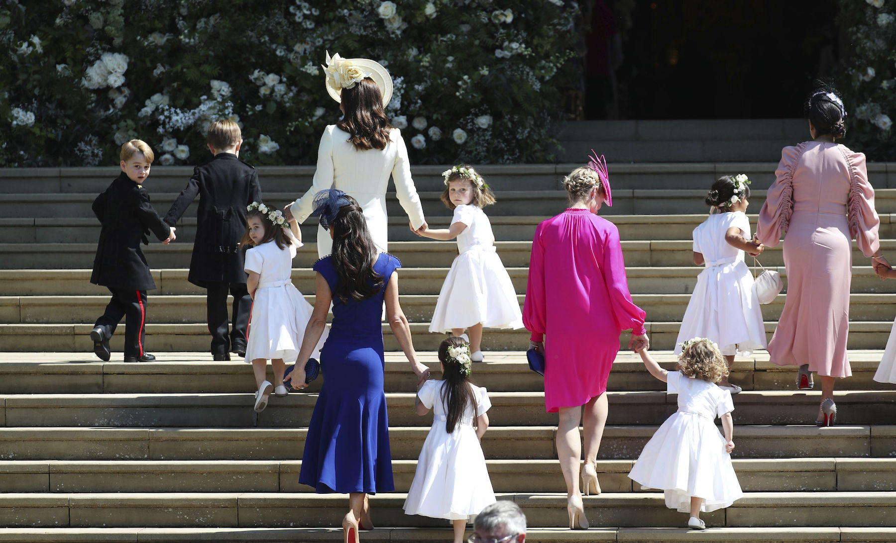 <div class='meta'><div class='origin-logo' data-origin='AP'></div><span class='caption-text' data-credit='Jane Barlow/pool photo via AP'>Prince George, Princess Charlotte, Kate, the Duchess of Cambridge and Jessica Mulroney arrive with the bridesmaids and page boys.</span></div>