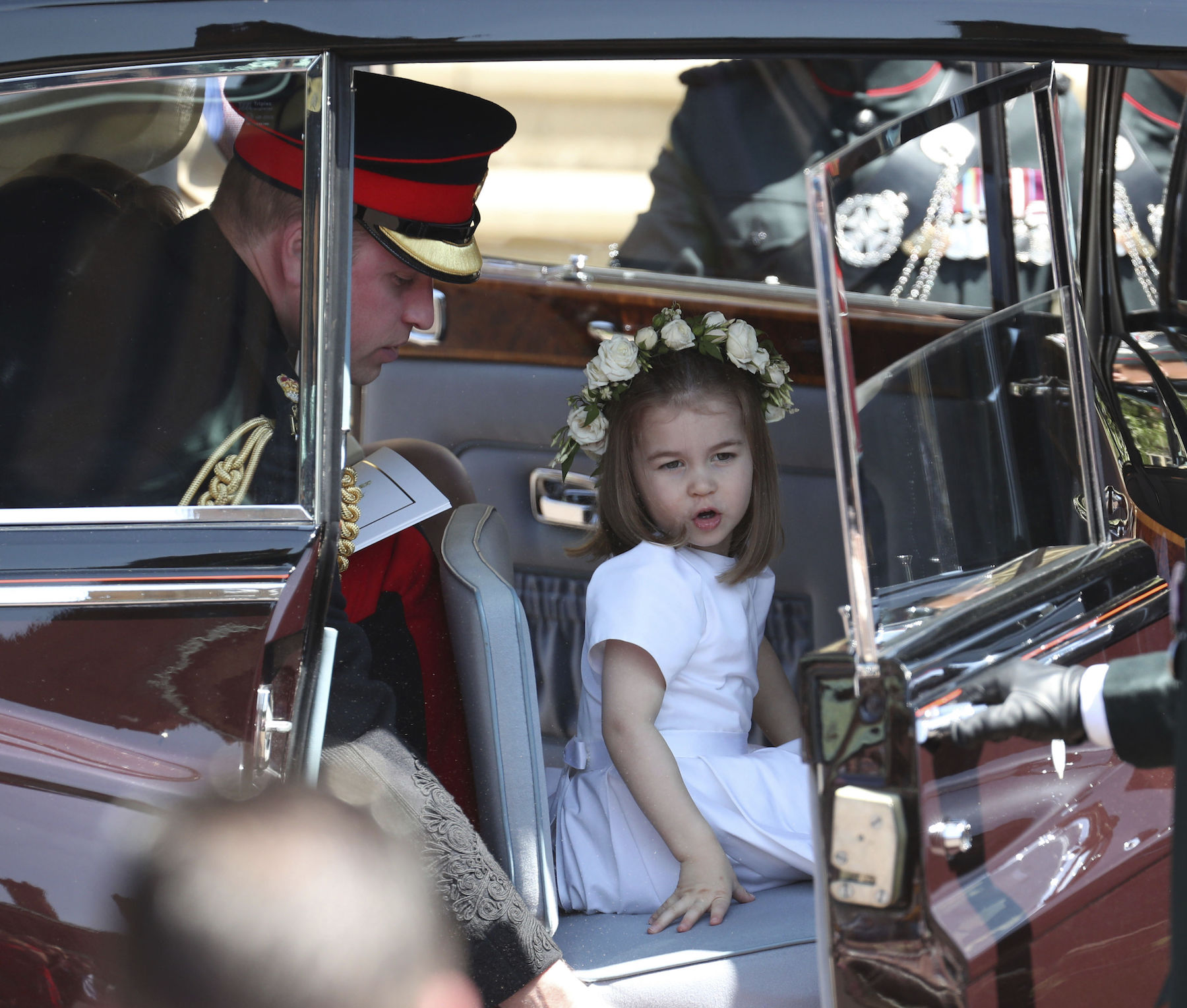 <div class='meta'><div class='origin-logo' data-origin='AP'></div><span class='caption-text' data-credit='Jane Barlow/pool photo via AP'>Princess Charlotte and Britain's Prince William leave after the wedding ceremony of Prince Harry and Meghan Markle at St. George's Chapel in Windsor Castle.</span></div>
