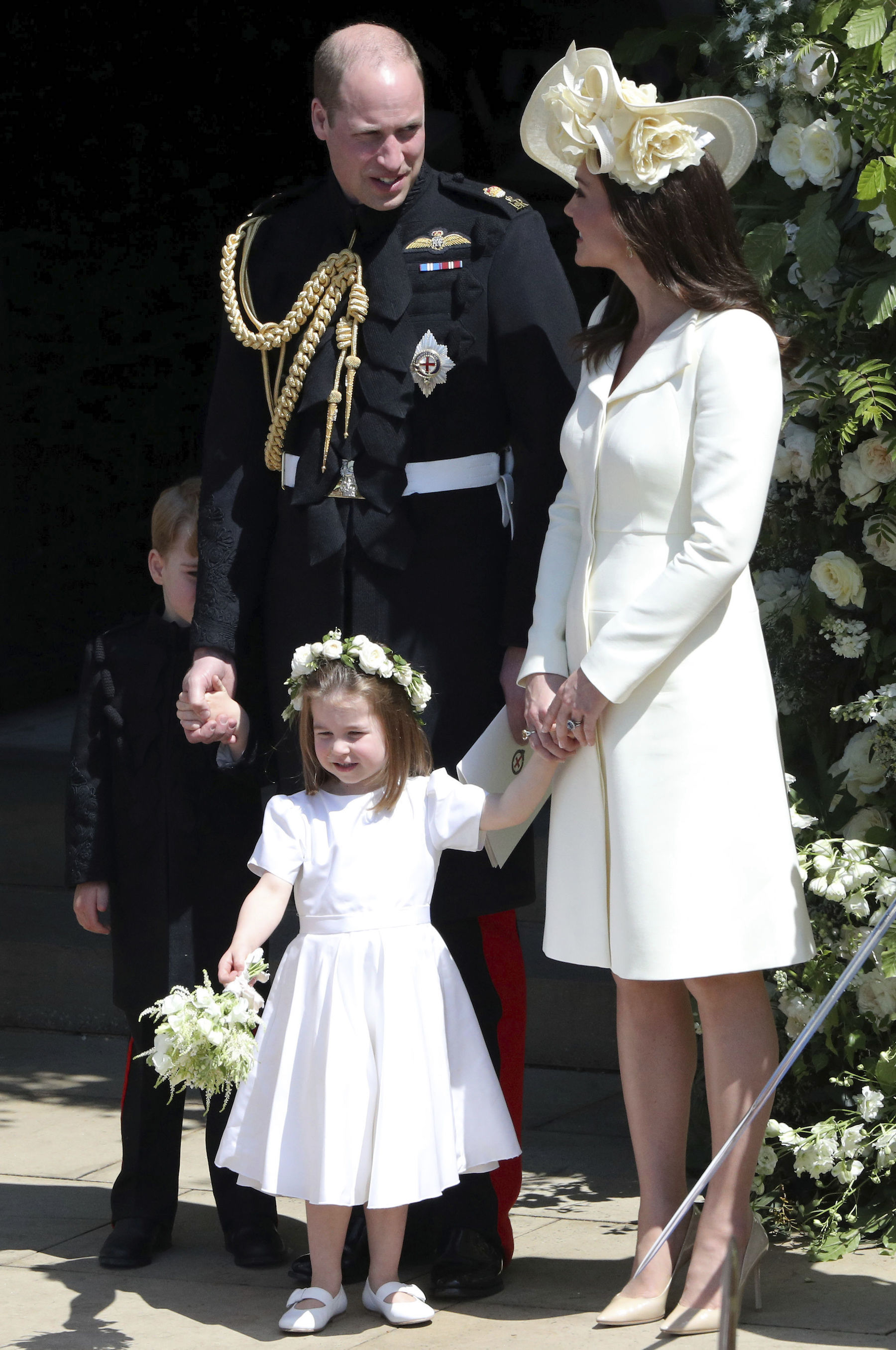 <div class='meta'><div class='origin-logo' data-origin='Creative Content'></div><span class='caption-text' data-credit='Andrew Matthews/PA Wire'>The Duke and Duchess of Cambridge with Prince George and Princess Charlotte leave St. George's Chapel in Windsor Castle after the wedding.</span></div>