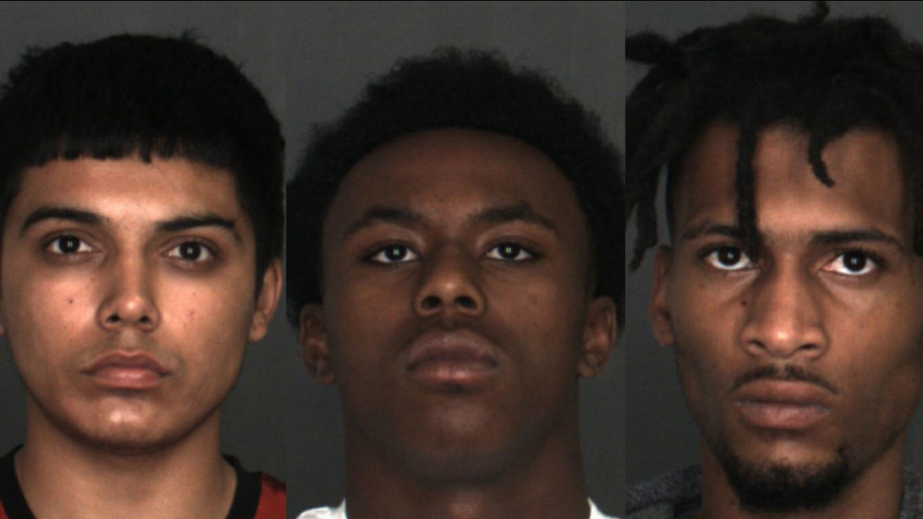 Drew Espino, 18, Justin Sumlar, 19, and Tyrin Smith, 20, are shown in mugshots.