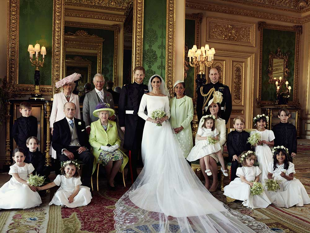 "<div class=""meta image-caption""><div class=""origin-logo origin-image none""><span>none</span></div><span class=""caption-text"">This official wedding photo of Britain's Prince Harry and Meghan Markle shows the bridesmaids, the page boys and the couple's families, including Queen Elizabeth II. (Alexi Lubomirski/Kensington Palace via AP)</span></div>"